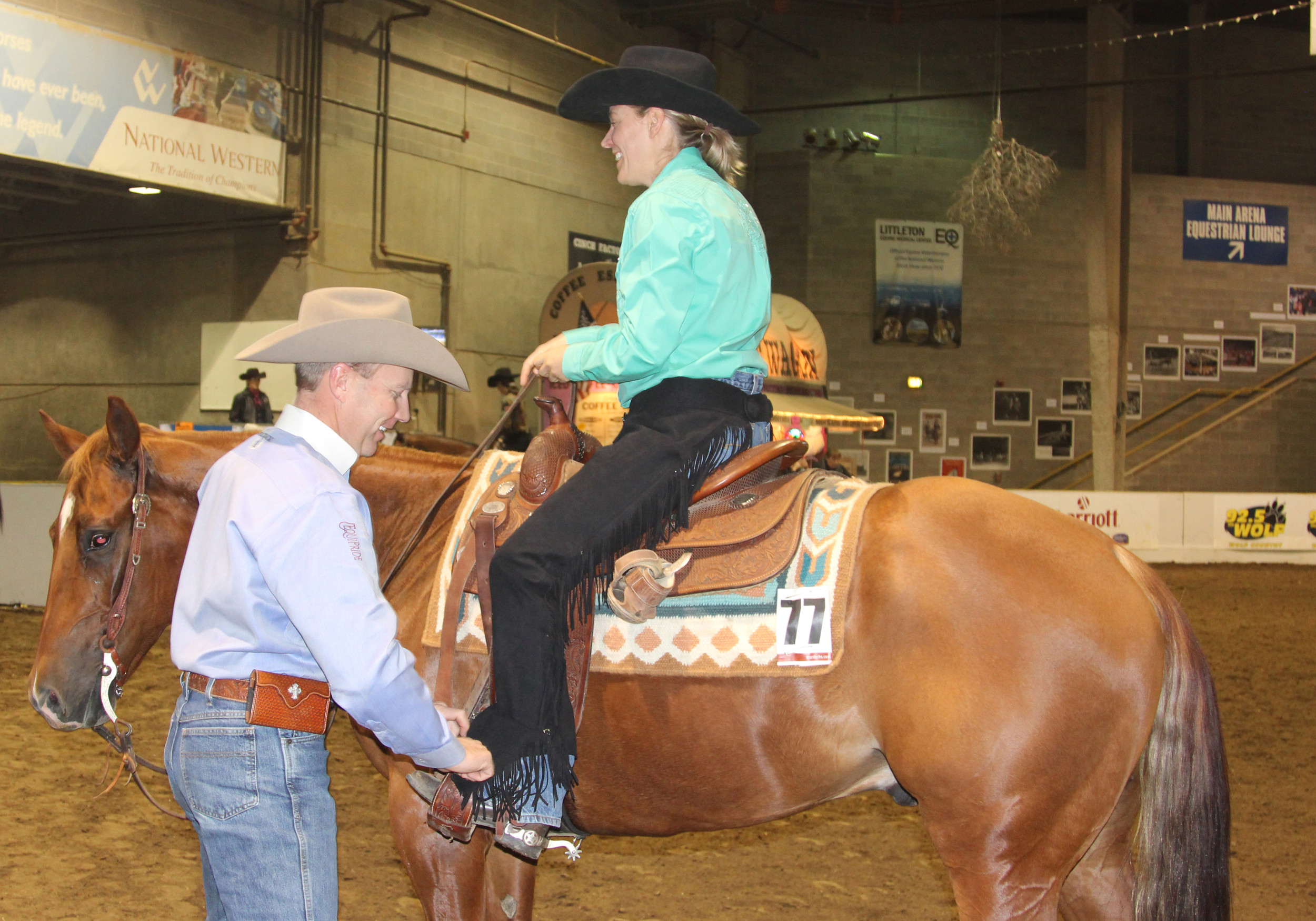 Trainer Devin Warren adjusts the saddle to fit horse owner Gina Ratcliff. Warren, owner of Franktown's Warren Performance Horses, had about 80 horses at the Jan. 5-9 Pre Denver Quarter Horse Show that precedes the National Western Stock Show.