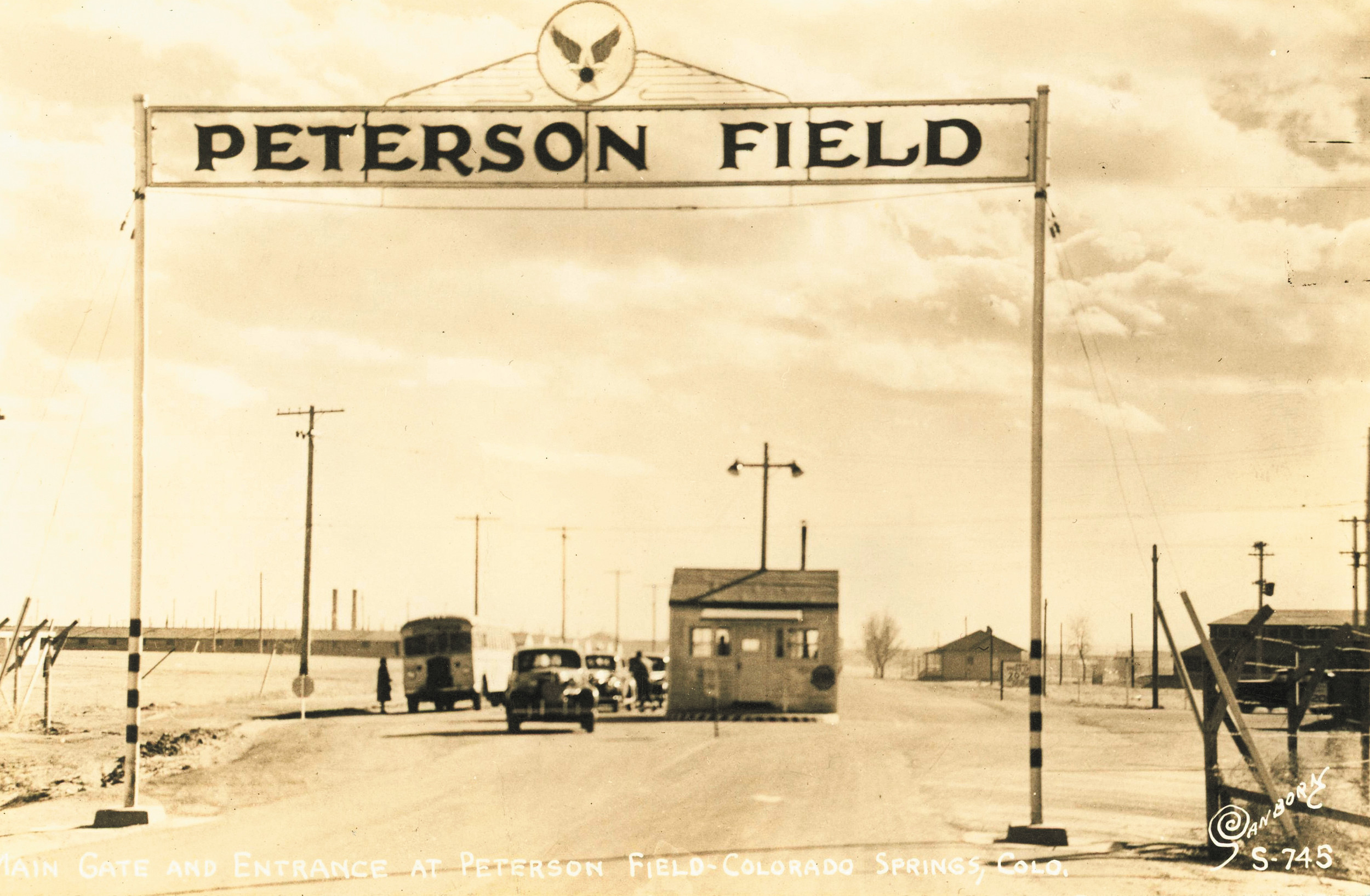 The photo shows the main gate at Peterson Army Air Field in 1943. The base was named for 1935 Englewood High School graduate Edward J. Peterson who was killed in a crash at the base in 1942.