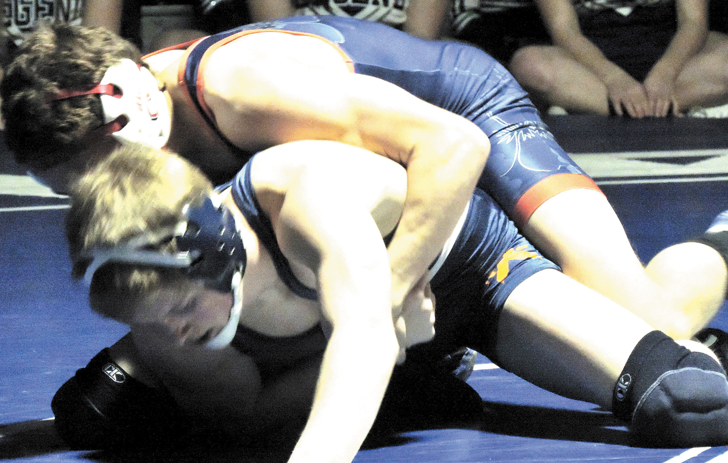 Chaparral's J.T. Stancil tries to get the shoulders of Ty Mervin of Legend to the mat.
