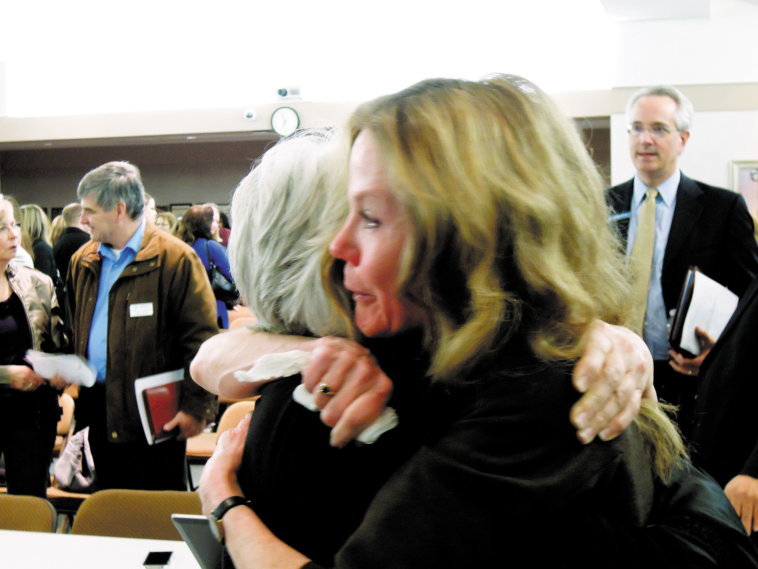 Jeffco Schools Superintendent Cindy Stevenson got a hug from a supporter after she announced her retirement during a Nov. 7 school board meeting. Stevenson resigned Saturday saying her relationship with the newly structured board is unworkable.