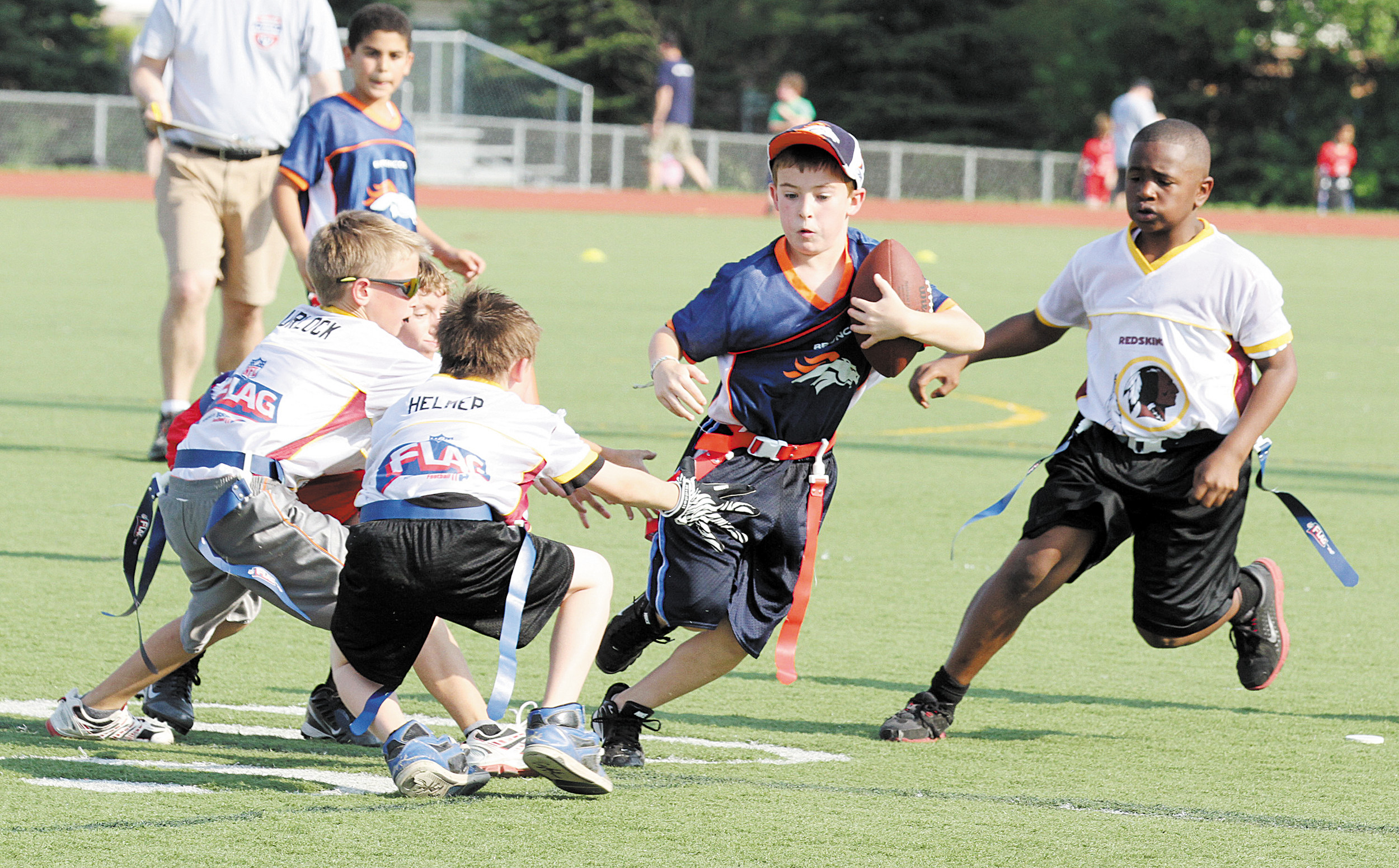 Boys compete in a National Flag Football game. National Flag Football, the largest youth football league in the nation is debuting in Colorado this spring and will offer to locations in the north metro area, one at Five Star Stadium in Thornton and the other at Broomfield High School.