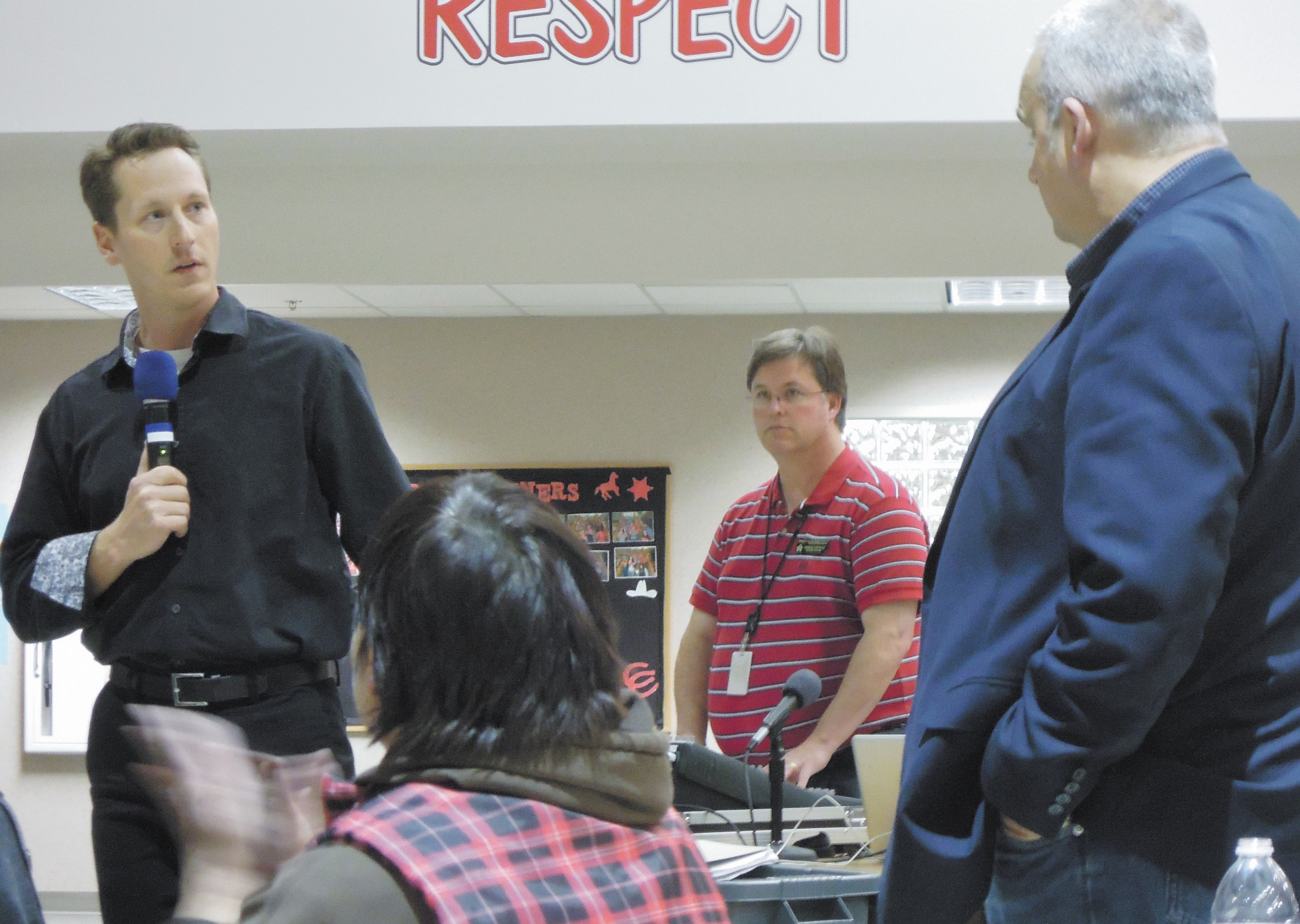 Teacher Kevin DiPasquale confronts school board president Kevin Larsen about the lack of teacher trust in the district and other concerns during the March 3 Board Unplugged meeting at Cimarron Middle School.