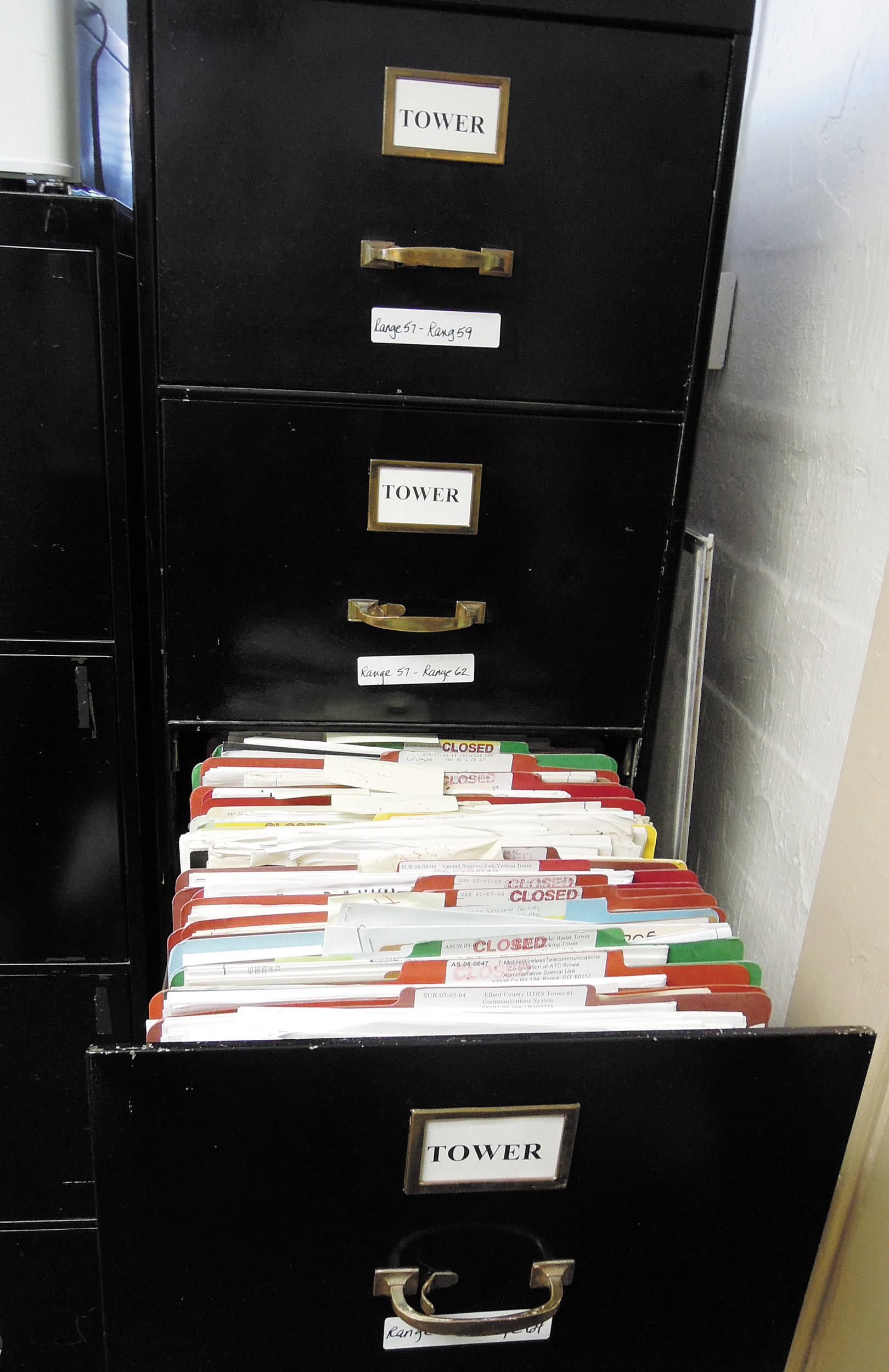 Files on cell phone towers around the county fill three drawers in the county's Community and Development Services department.