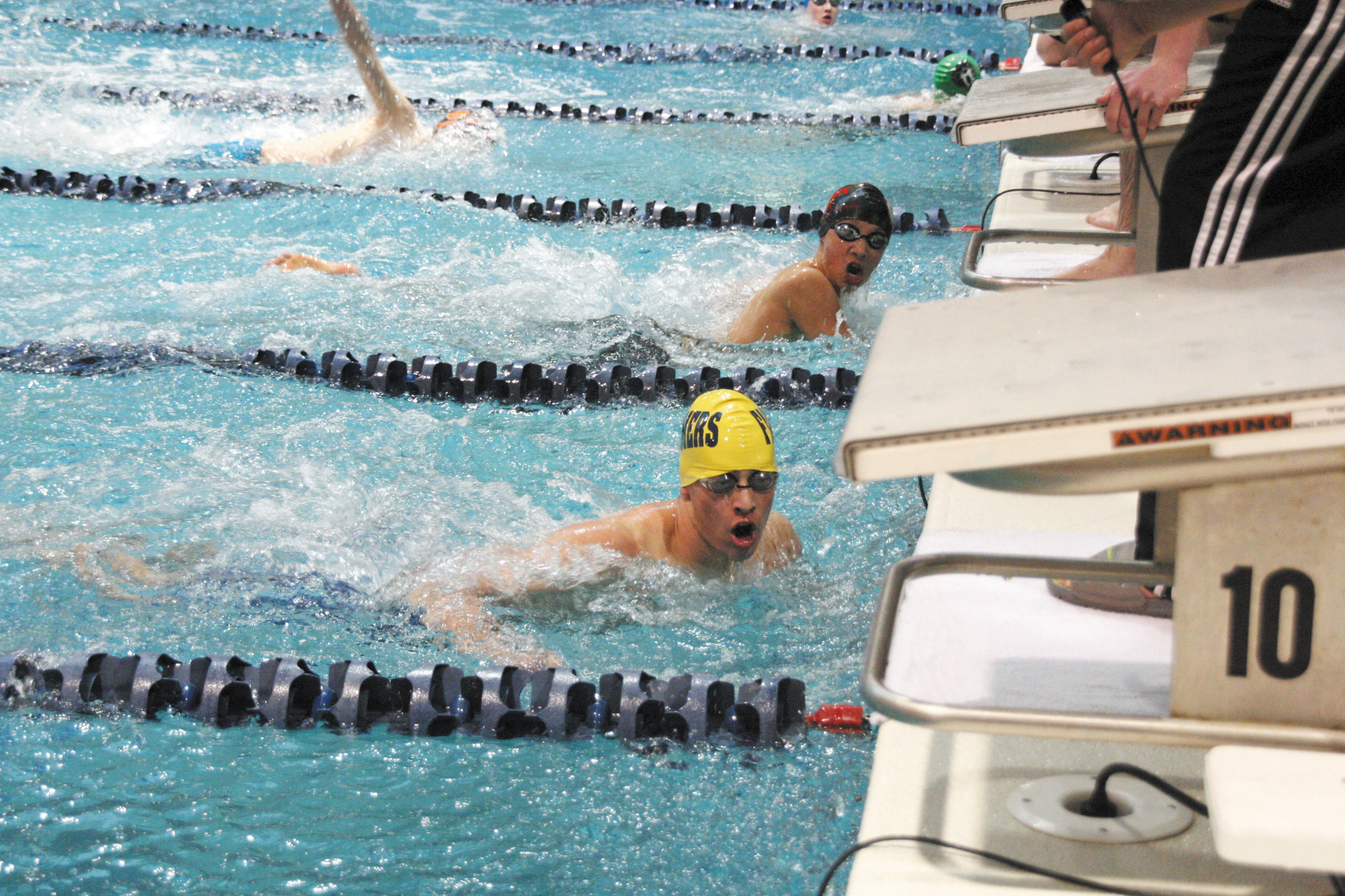 Wheat Ridge's Max Sweeney looks for his time and how his team finished their 200 Medley Relay during Saturday's Dick Rush Memorial Swim-Dive Invitational.