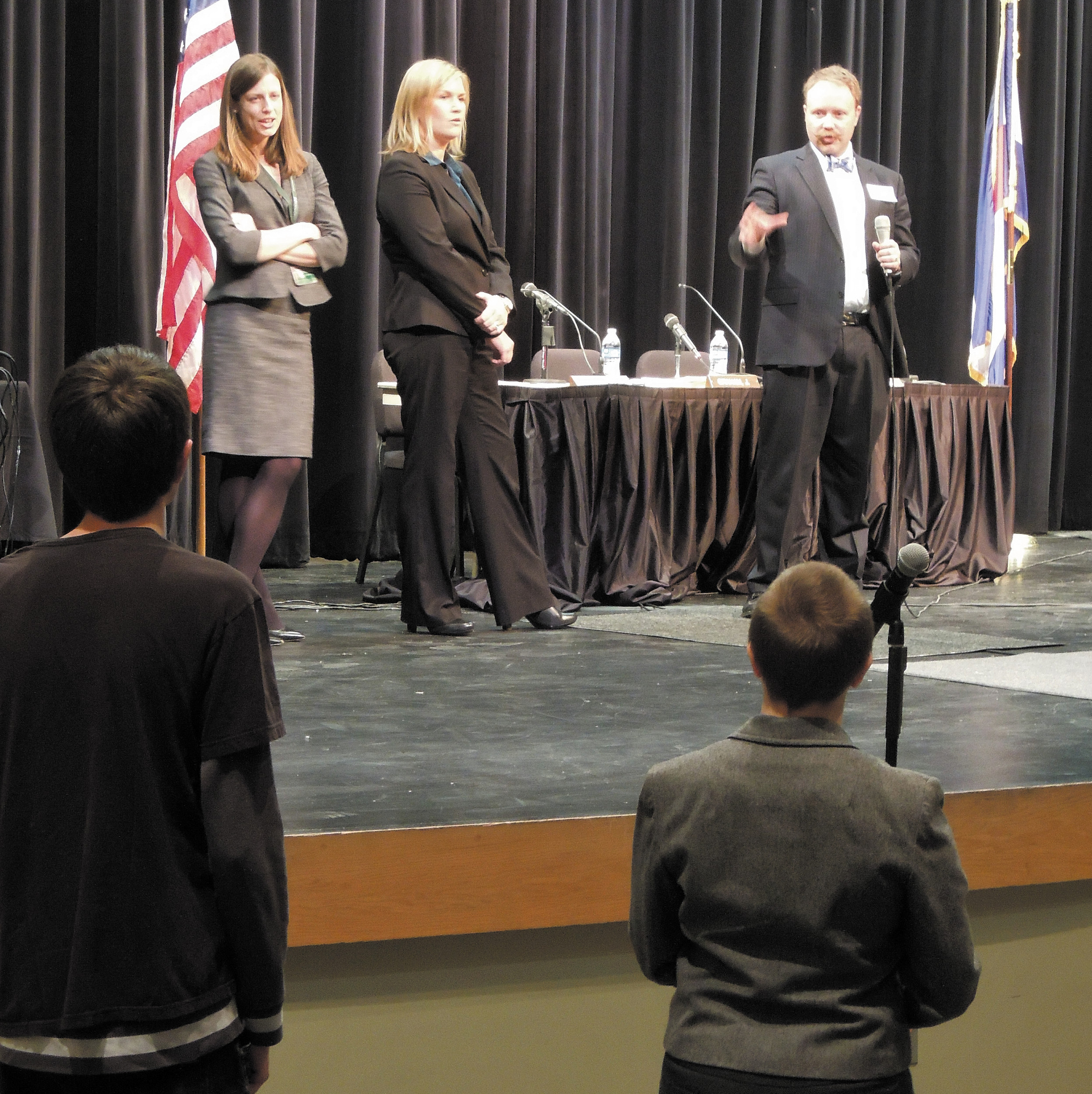 Rock Canyon High School students listen as Colorado Court of Apeals baliff Matthew Skeen answers a question. To his left are attorneys Meredith Van Horn  and assistant attorney general Jenny Campos, who presented cases at the school. Photo by Jane Reuter