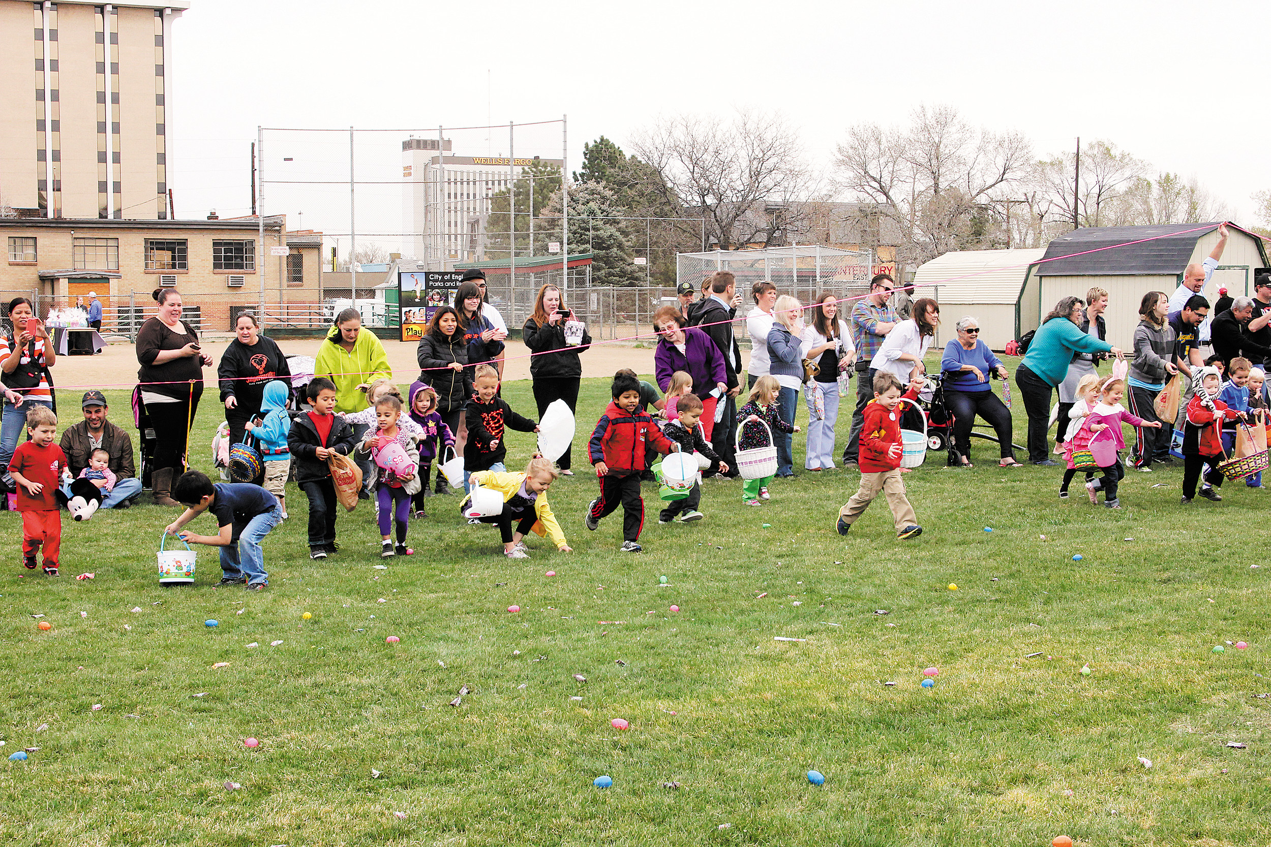 The starting horn sounded and children rush to scoop up goodies at the April 12 Englewood Egg Scramble. There were a lot of kids and the area was picked clean in a matter of minutes. Photo by Tom Munds