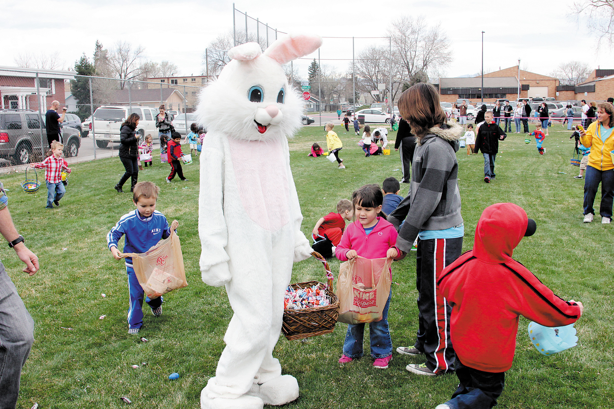 The tall white bunny with the basket of candy was popular with children at the Englewood Great Egg Scramble. The bunny handed out hugs and candy at the April12 event. Photo by Tom Munds