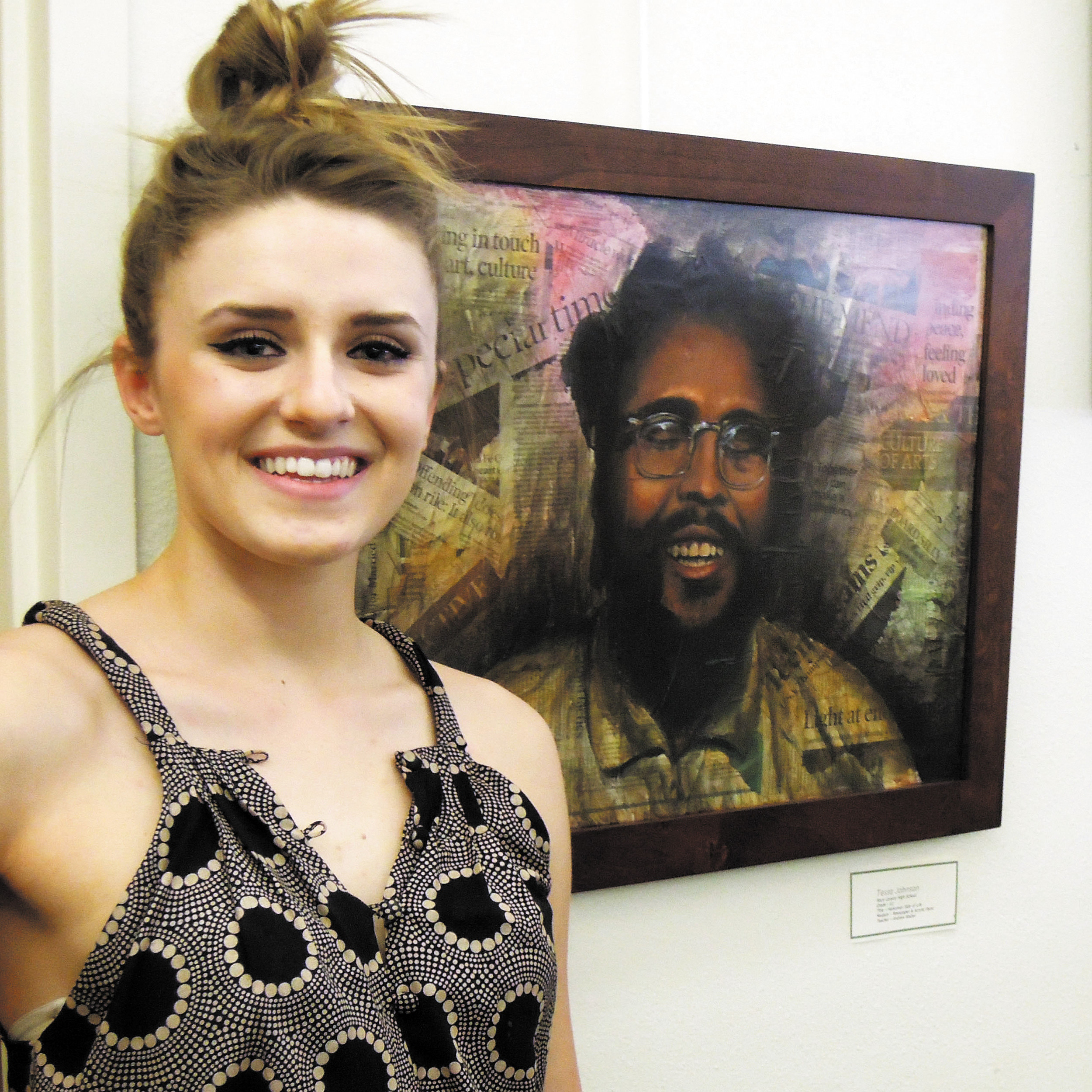 "Rock Canyon High School senior Tessa Johnson stands next to her award-winning work, ""Humorous Side of Life,"" moments before winning top honors for the piece at the Lone Tree Golf Clubhouse April 22."