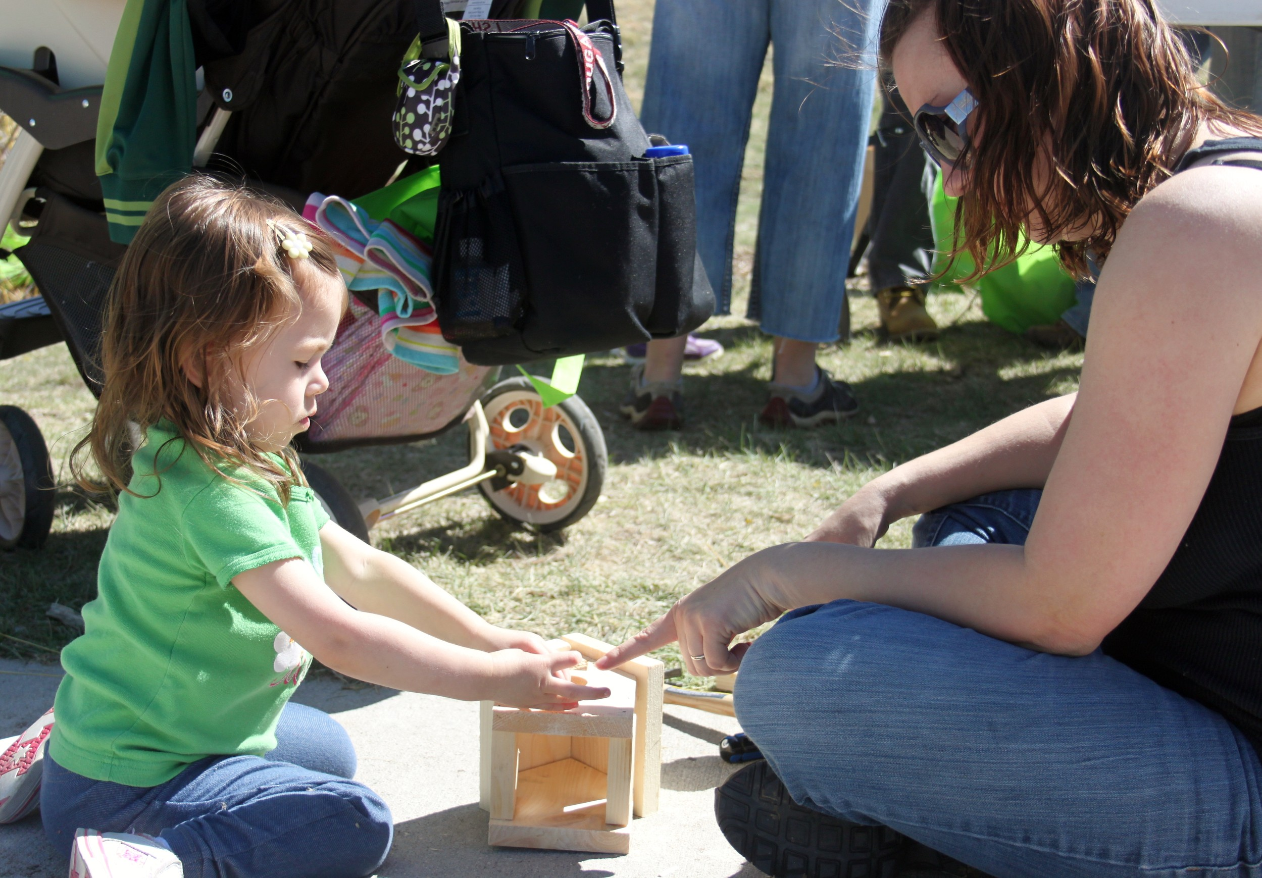 Cloe Kamen, 3, of Parker, helps her mom, Lynsey, assemble a birdhouse during the town's Arbor Day celebration April 26 at Tallman Meadow Park.