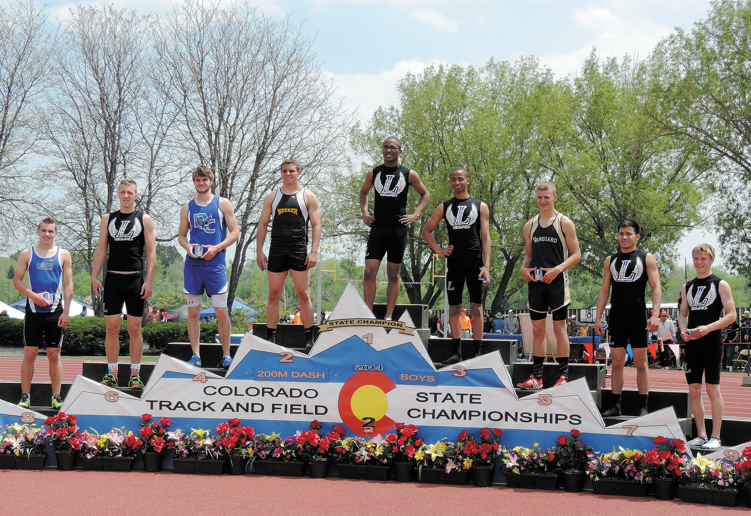 There were six Lutheran athletes on the podium May 17 for the Class 2A 400 meters. From left, Josh Clausen (sixth place), Chris Youngs (first place), Kent Harris (third place), Darian Perez (seventh place) and Ryan Lee (ninth place).