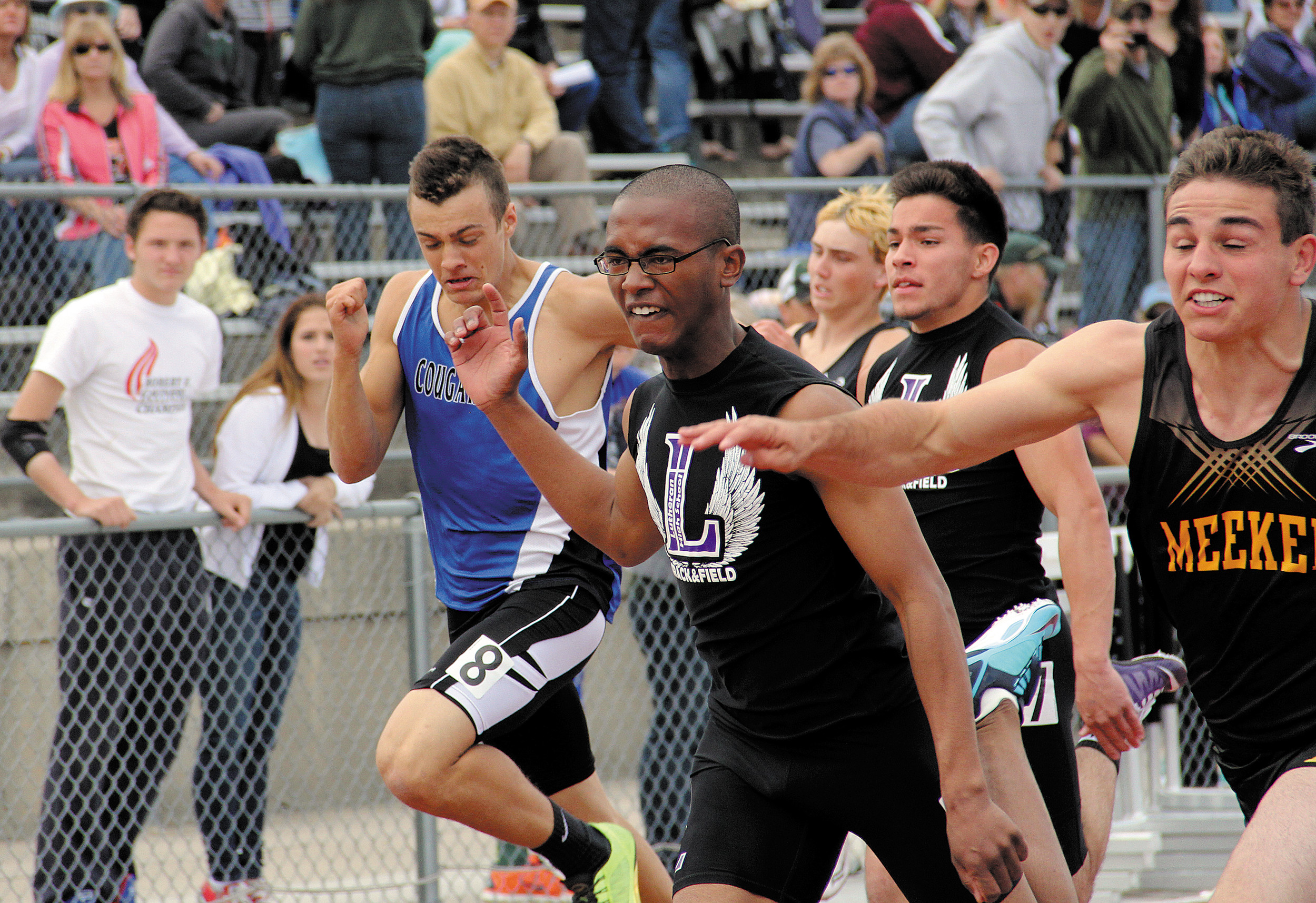 A late thrust by Meeker's Trenton Shelton, far right, gave him the 100 meter win over Lutheran sophomore Chris Youngs, center. The two finished one-two in the preliminary heat and owned the fastest two times in the event heading into the Class 2A finals held later in the weekend in Lakewood.