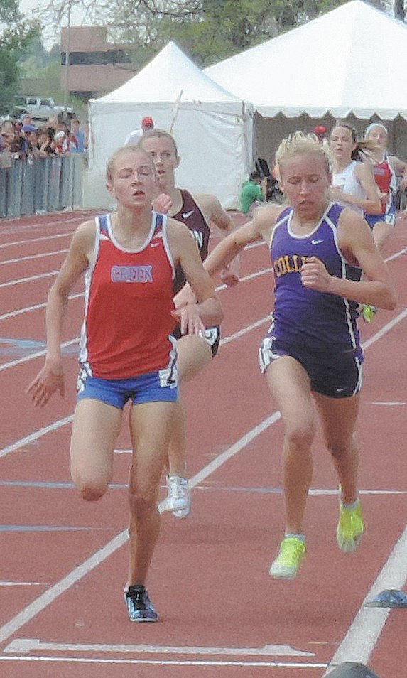 Cherry Creek junior Jordyn Colter, left, wins the Class 5A 1600 meter state championship at the finish for her second victory of the meet. She defended her 1600 meter title and also won the 800 meters.