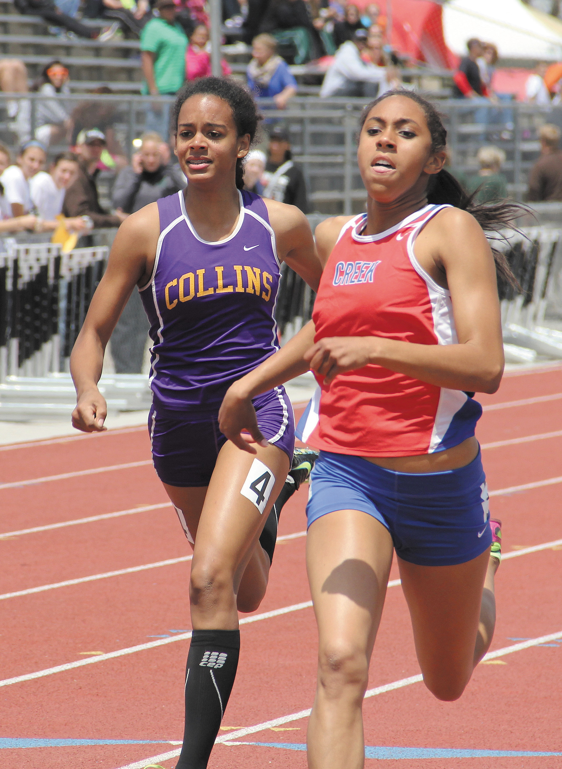Cherry Creek sophomore Ashley Miller, right, finished just fast enough in the 200 meter prelims May 15 to make it to the 5A finals. Miller crossed in a time of 24.72 seconds, the ninth fastest among all preliminary heats.