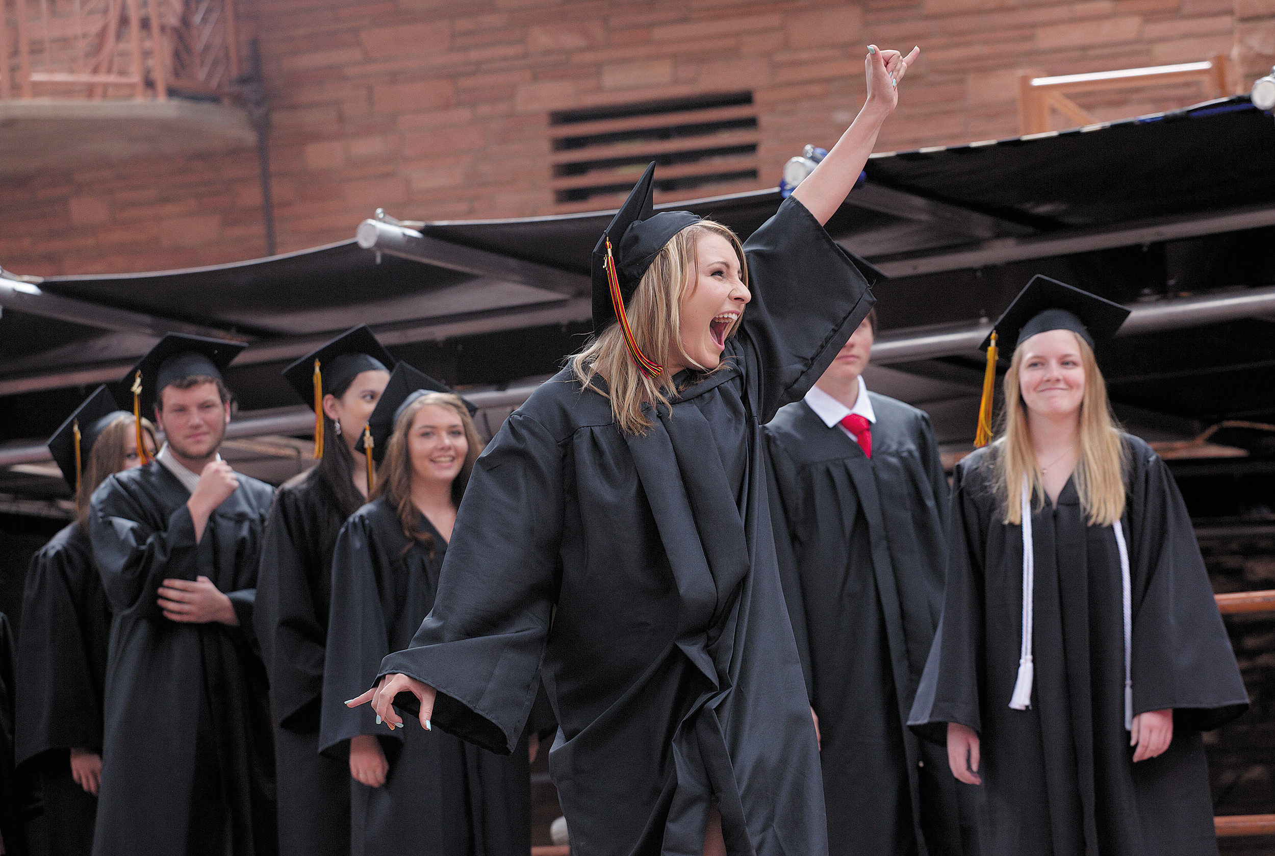 Hayley Carpenter waves in excitement at the crowd after her name is called during Castle View High School's graduation ceremony at Red Rocks Amphitheater on May 21.