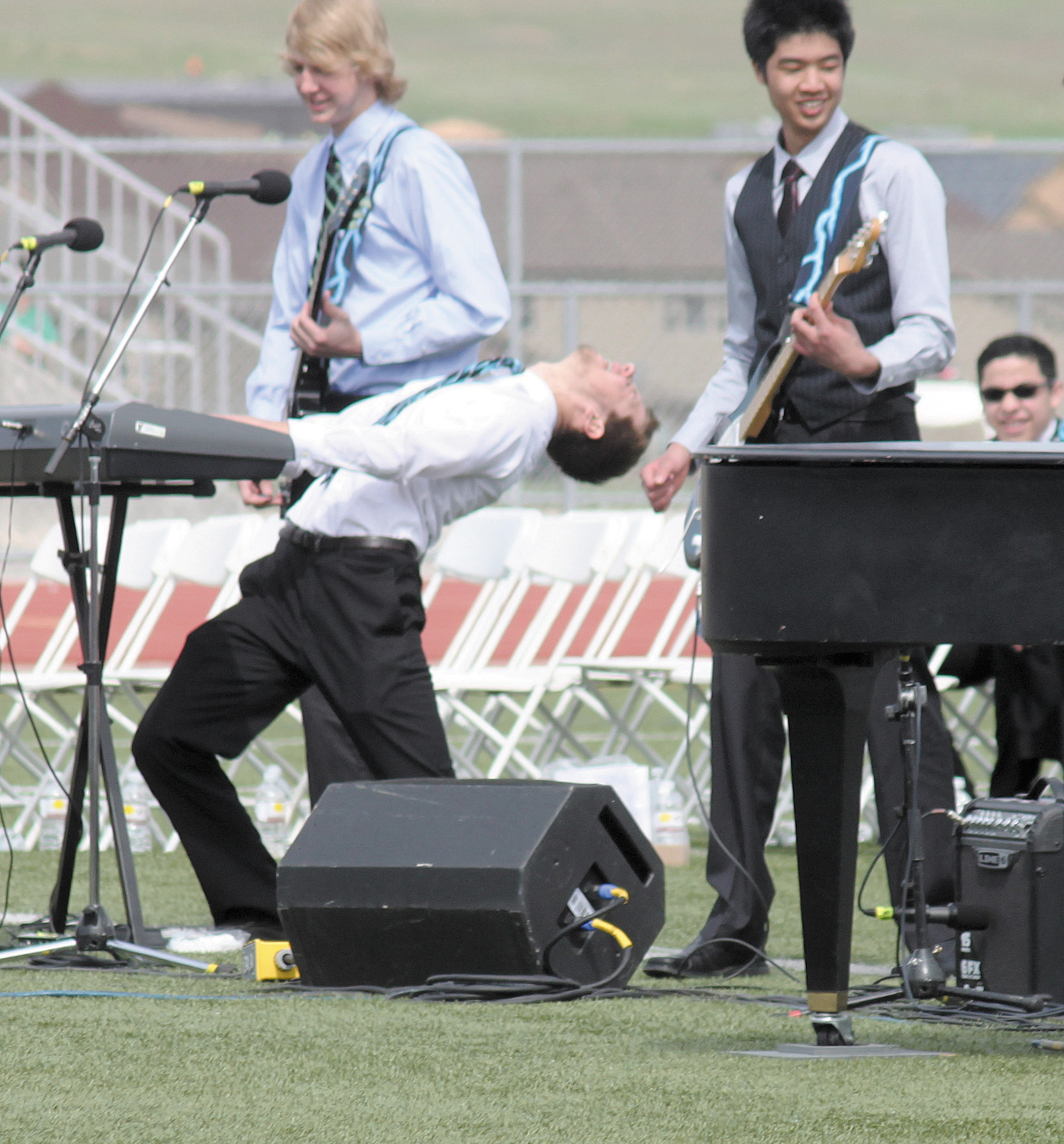"From left, Ryan Hathaway on guitar, John Wolfe on keyboard and Jerry Ho on guitar rocked their fellow classmates with Boston's ""Long Time"" during ThunderRidge High School's May 22 graduation ceremony."