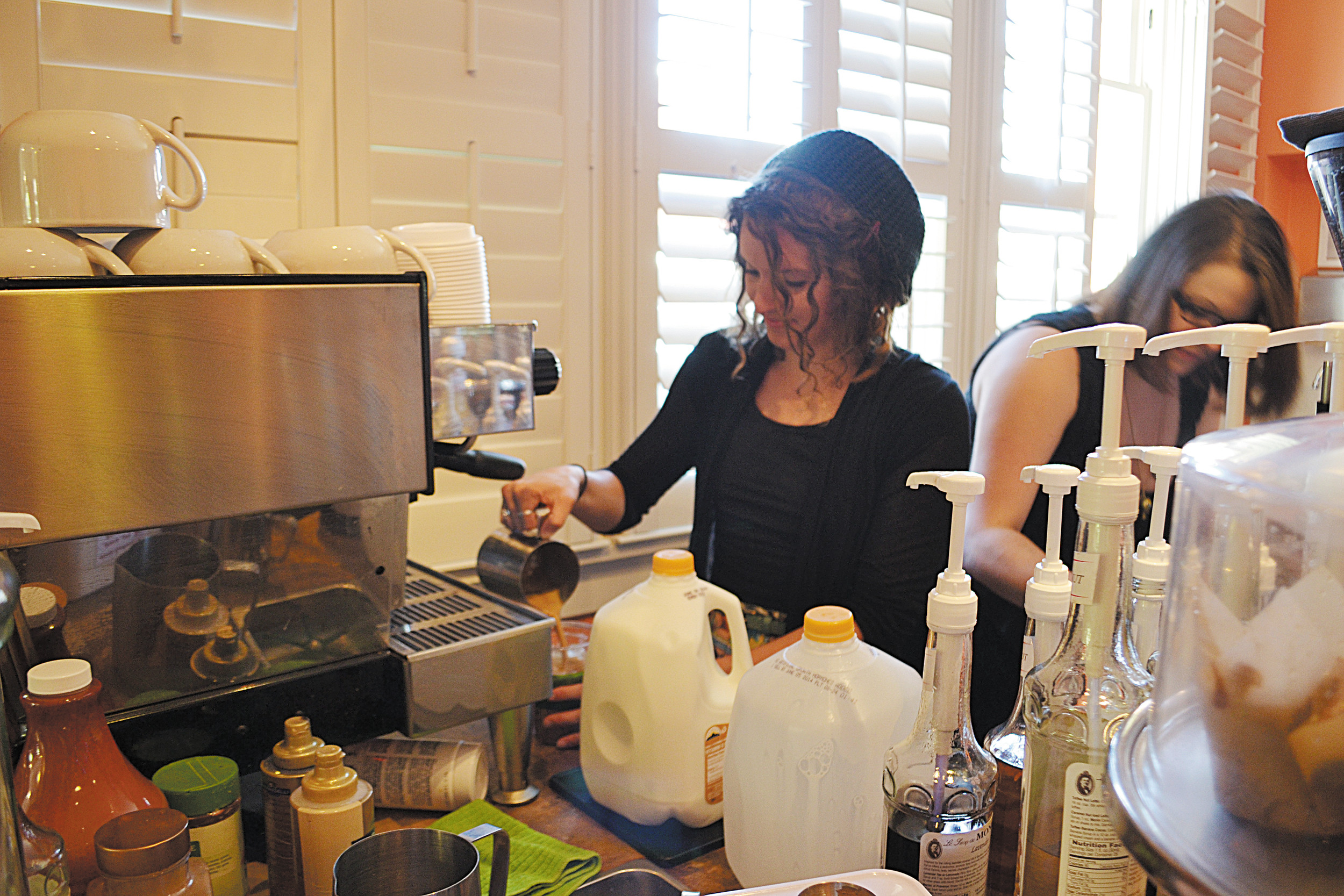 Volunteer, Charissa Classen, creates a drink behind the bar. The coffee house is largely run by its 55 volunteers and seeks more individuals to help out. Photos by Crystal Anderson