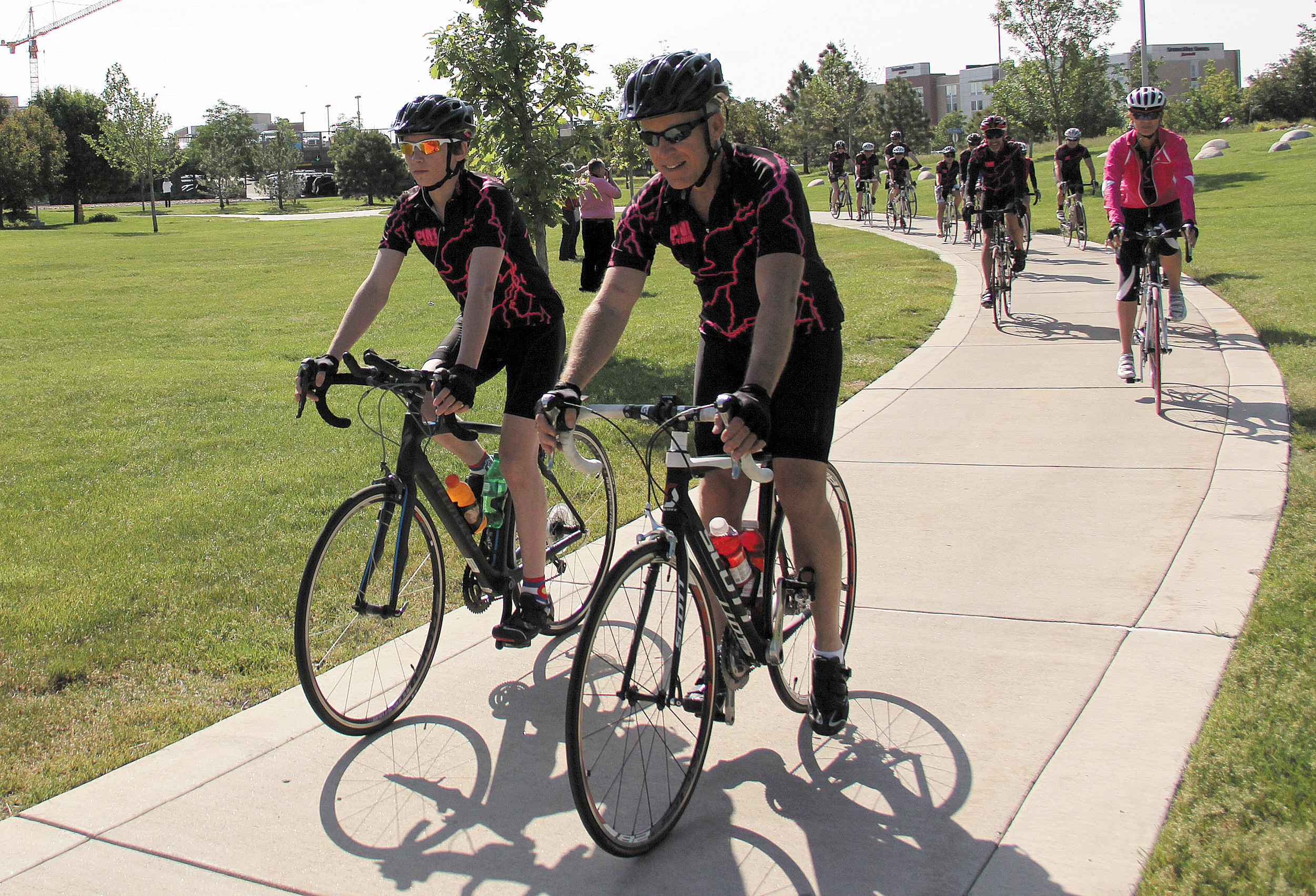 Bryan Warnecke, 15 of Castle Rock, and his father, Steve, lead the pack as the two hosted the Pink Lightning Tour to raise money and awareness for cystic fibrosis Saturday June 7.The 29.76 mile ride stretched from Children's Colorado's main campus at the Anschutz Medical Campus in Aurora to Children's Colorado's North Campus in Broomfield.