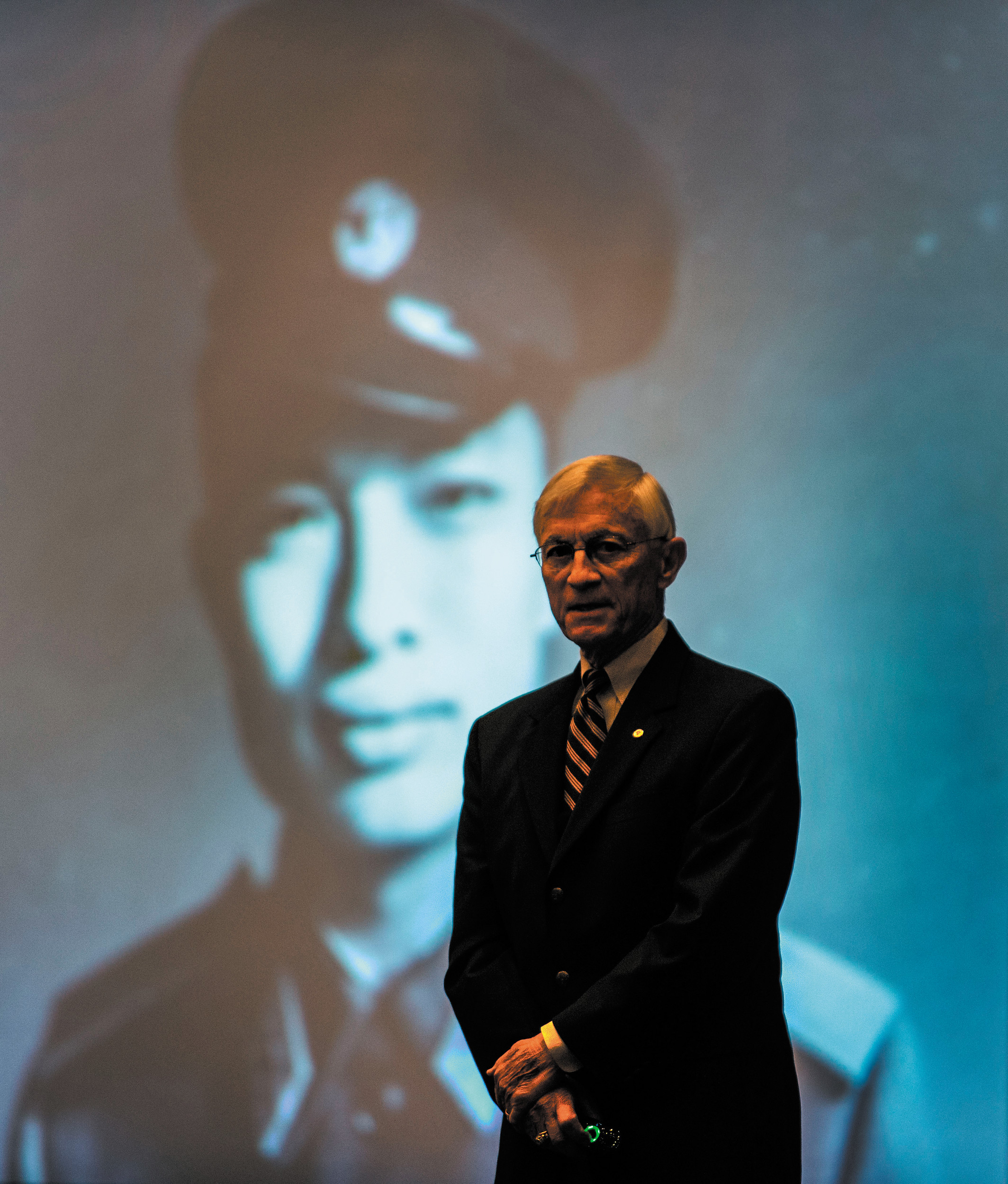 Retired Brig. Gen. Dan Cherry, stands in front of an image of Nguyen Hong My, a North Vietnamese fighter pilot he shot down over Hanoi in 1972. Cherry served as keynote speaker for the 2014 Colorado Aviation Business Association luncheon, Thursday, June 19 at The Wildlife Experience in Parker. Cherry recalled the story of how he was reunited with Hong My more than three decades later to become friends. The annual luncheon kicked off Colorado General Aviation Appreciation Week, which showcases how aviation plays a significant role in the state's economy.