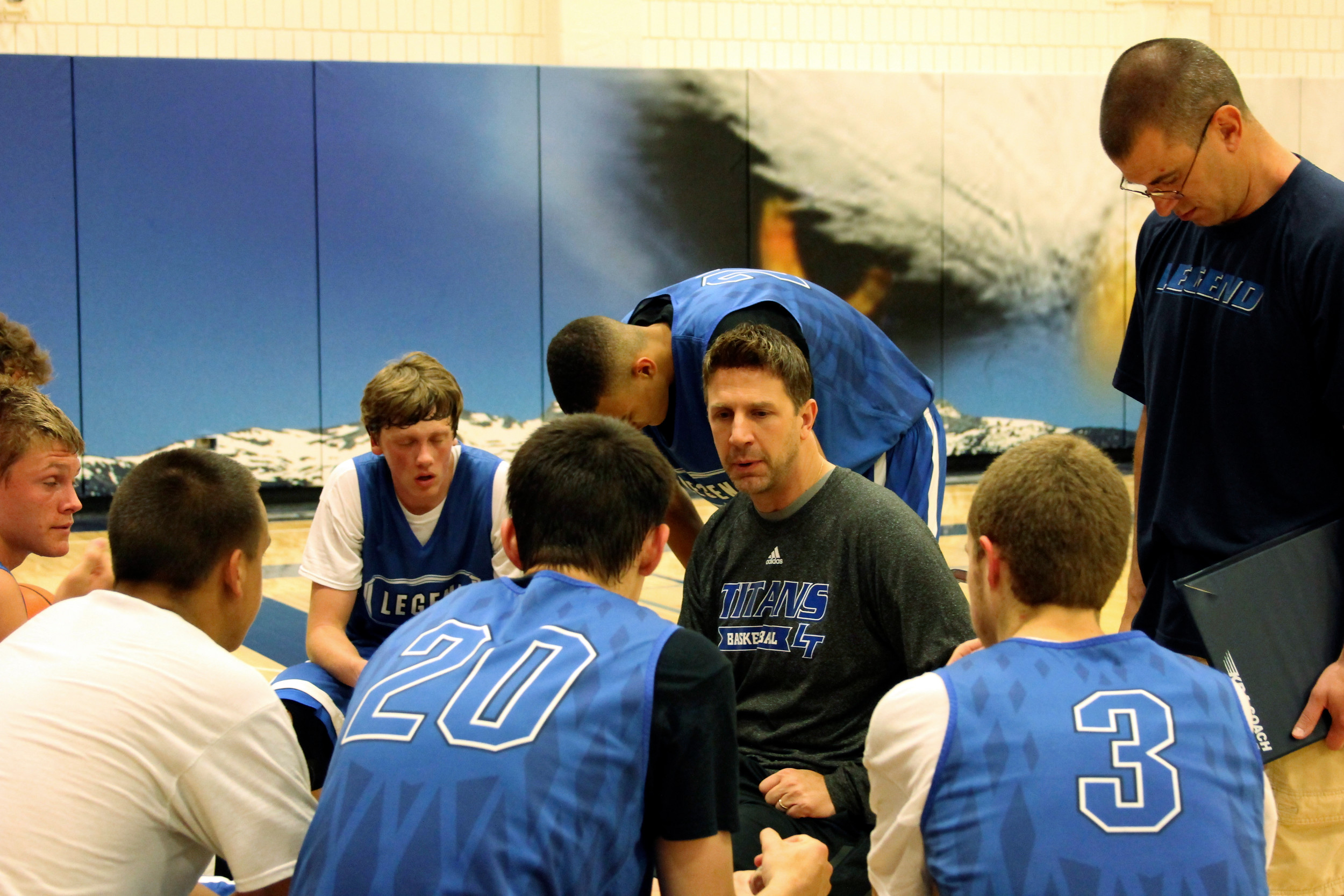 Scott Fellers, Legend head basketball coach, talks to his players at the conclusion of the three-day Continental-Centennial tournament. The coach said he was pleased with his team's performance as they went 5-1 in the June 19-21 tournament.