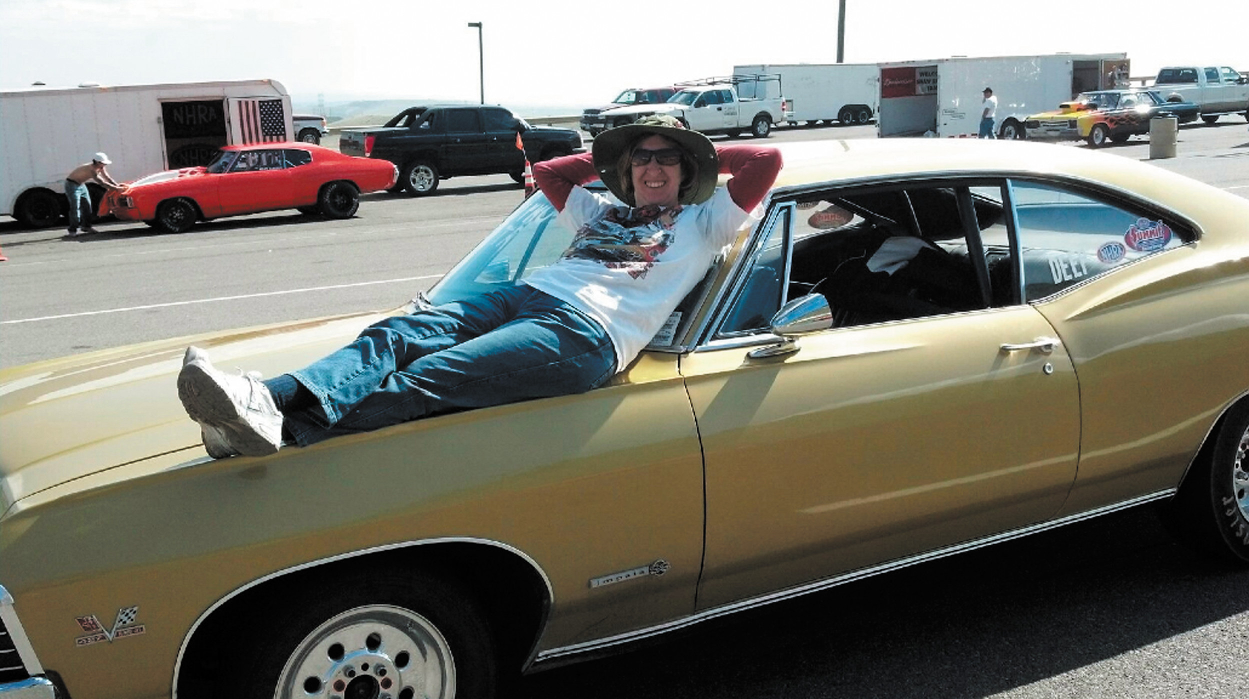 Cheryl Muhr takes a break on top of her 1967 Chevy Impala. Muhr spends a lot of time enjoying the sport of racing with her husband, John, at Bandimere Speedway in Morrison.