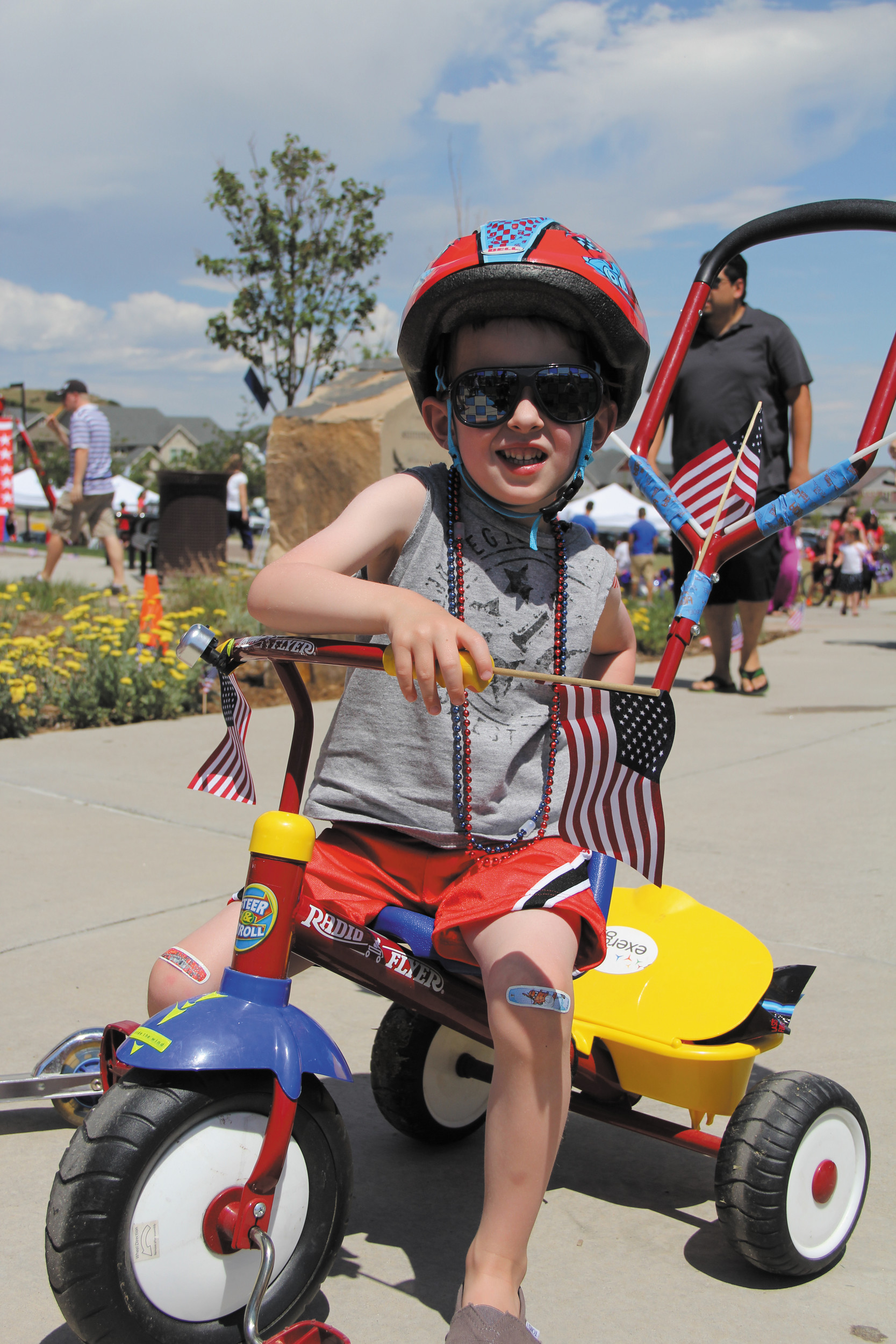 Ayden Stamey, 3, prepares to ride his bike in the Meadows annual Fourth of July Children's Bike Parade at Bison Park.