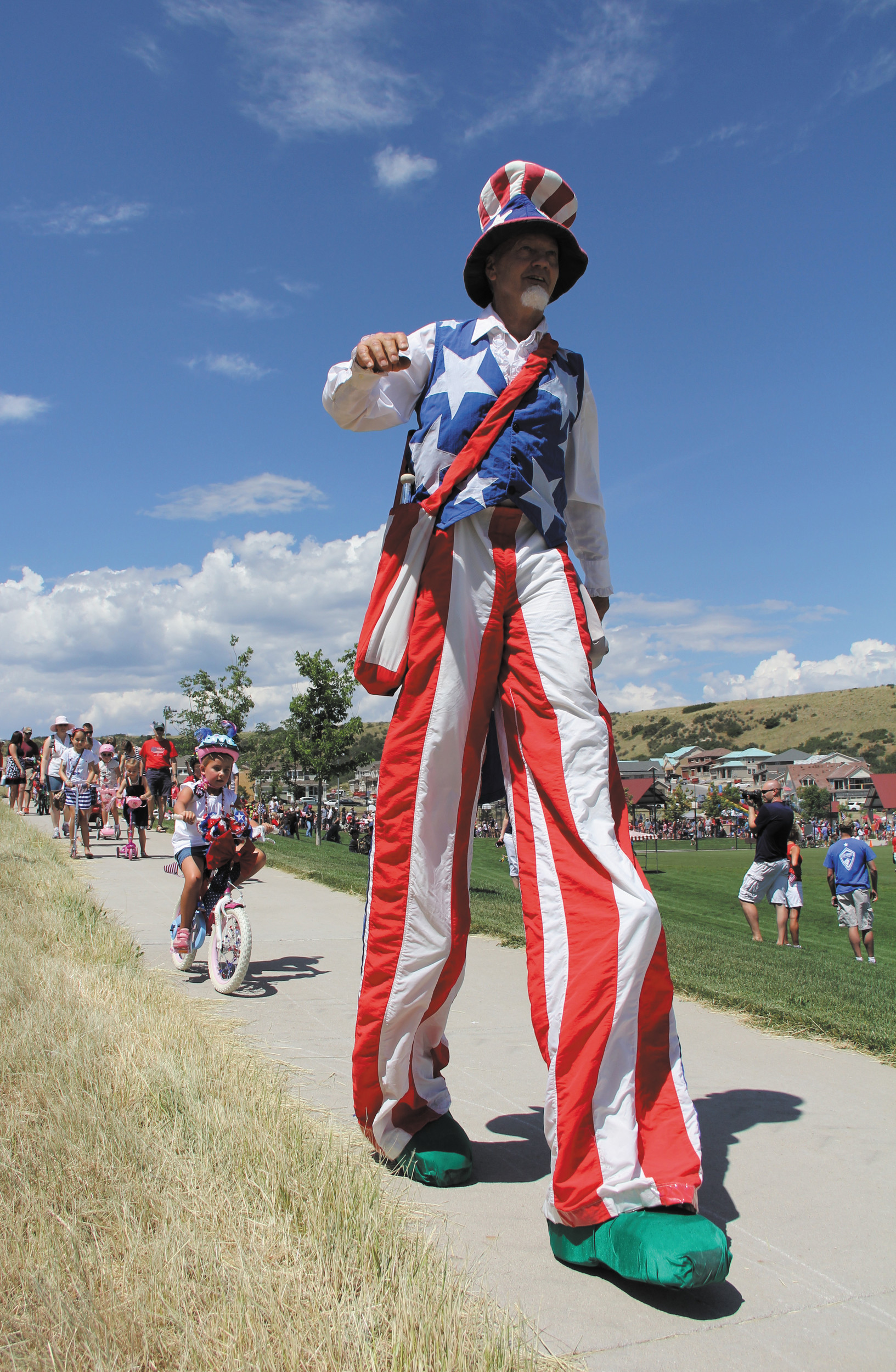 """Red and White, Blue Suede Shoes, I'm Uncle Sam, How do you do?"" ... Youngsters came out in droves to ride their bikes with Uncle Sam at the Meadows annual Fourth of July Children's Bike Parade in Castle Rock."