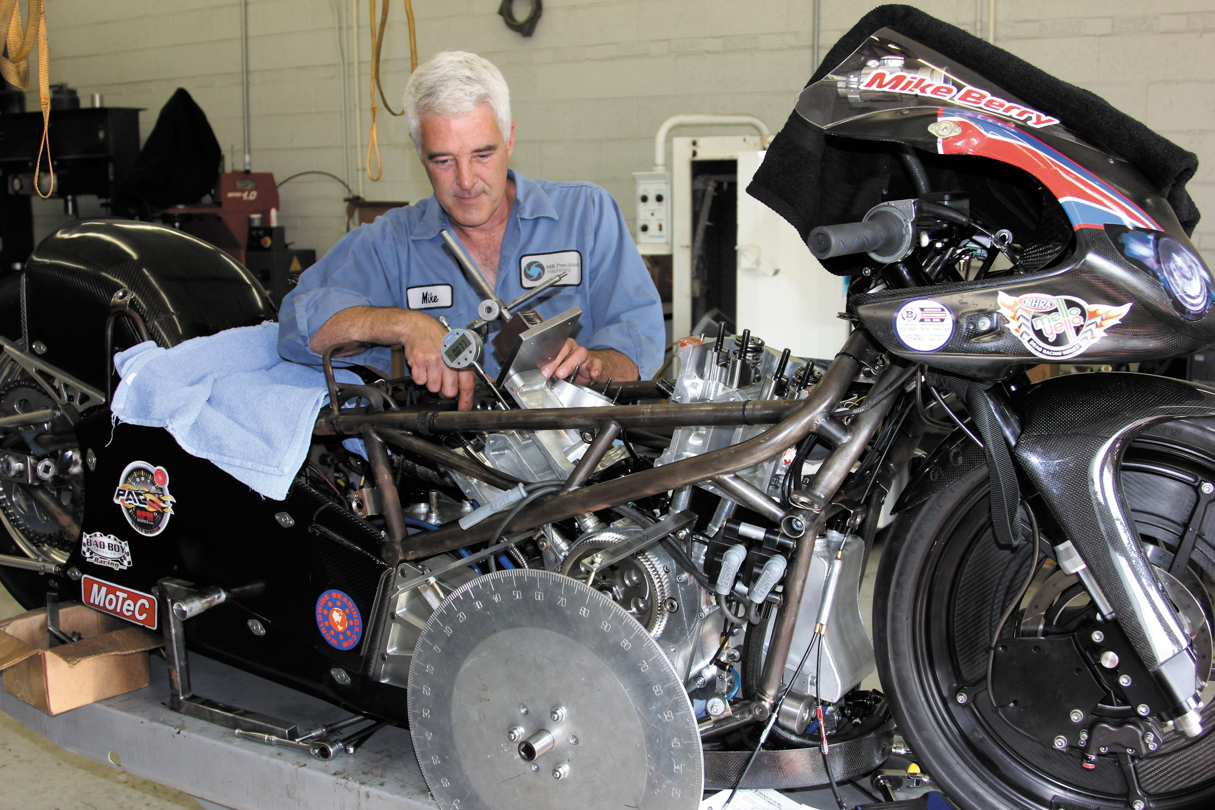 Mike Berry works on assembling the motor on his pro stock motorcycle. Berry manufactures many of the parts for the motor and runs tests on the engine in his Englewood shop. He said he has been struggling to make his bike competitive. He said he hopes to be ready and qualify at the Mile High National Drag Races July 19-22 at Bandimere Speedway in Morrison.