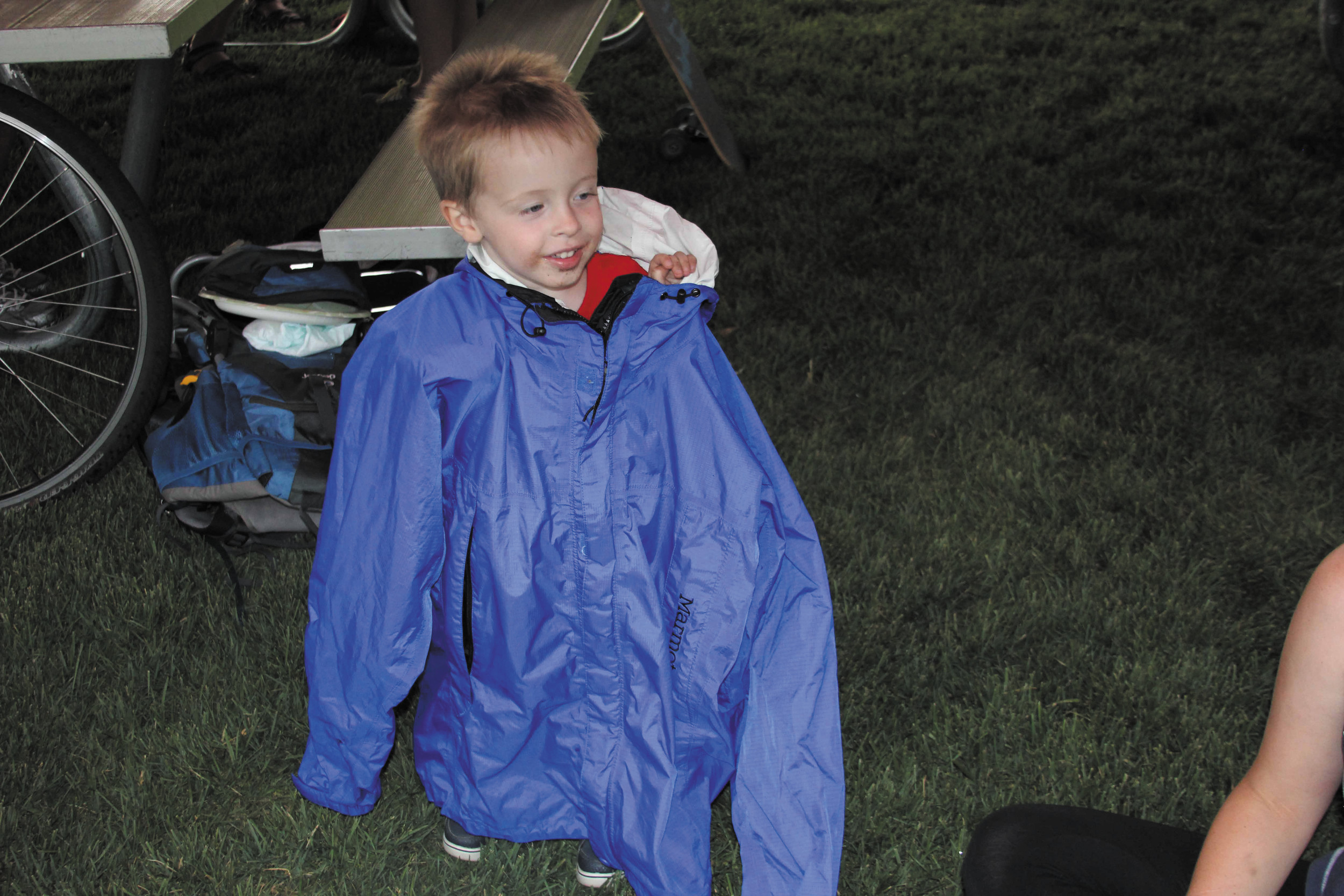 Sebastian Hutchison is snug and warm wrapped up in his dad's jacket when the July 4 rainstorms and wind made it a bit chilly at the July 4 Family Fun and Fireworks festivities at Cornerstone Park. The rain came and went, the weather turned warmer and the event went on as planned.