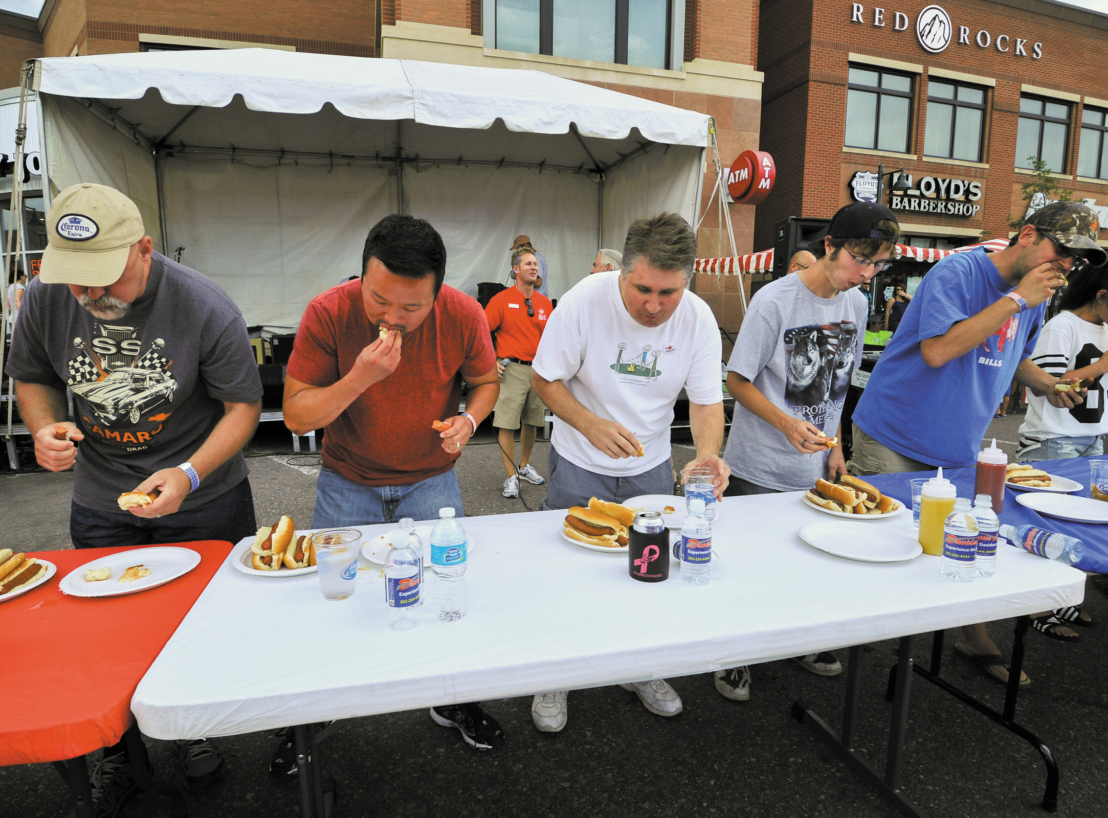 Competitors in the HRCA Hot Dog Eating contest try to see how many they can consume in 5 minutes on July 4.