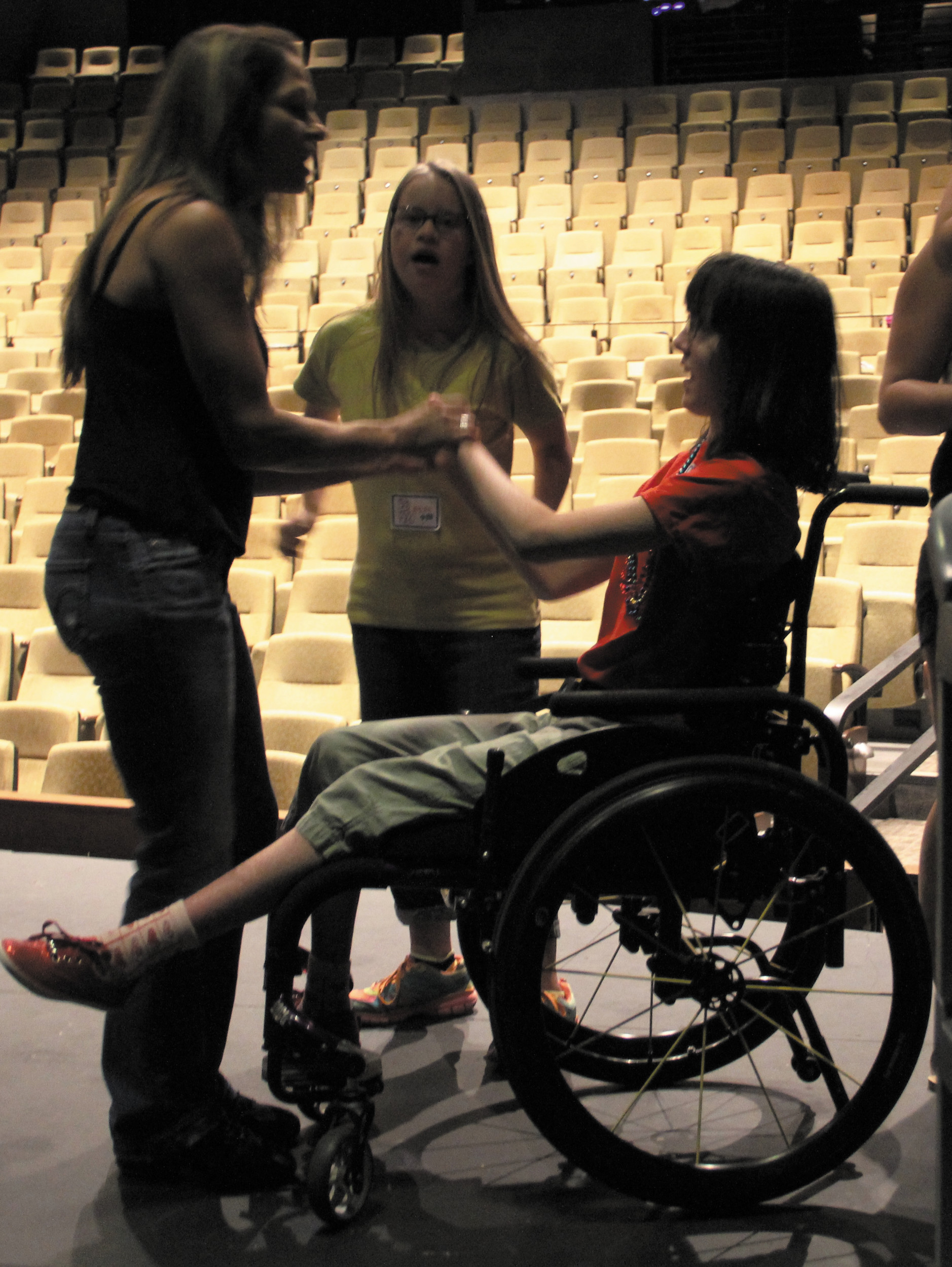 "From left, Liane Adamo, executive director and choreographer of Inspire Creative, dances with Baylee Ginther, 16, of Highlands Ranch, and Kayla Kopp, 15, of Franktown, during the ""Dylan's Down With the Arts"" special needs theater camp at the PACE Center."