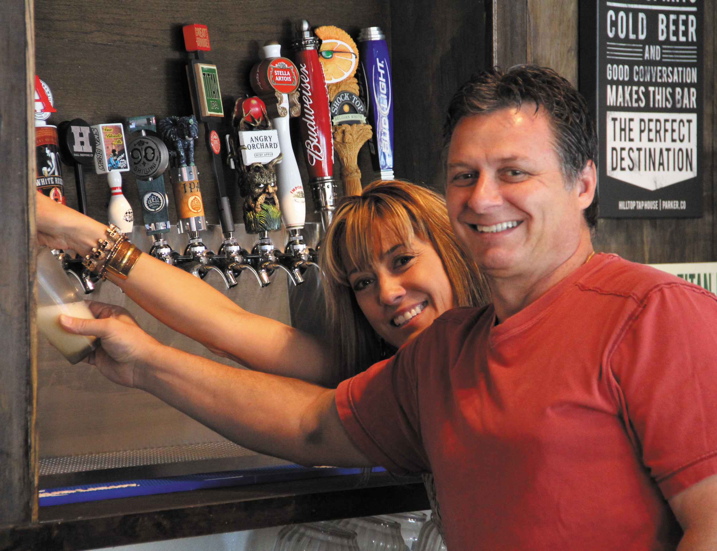 Hilltop Tap House owner Bill Psyllas and bartender Teresa Donahue pour a local brew July 7. The sports bar opened last month near Hilltop Road and Pine Drive.