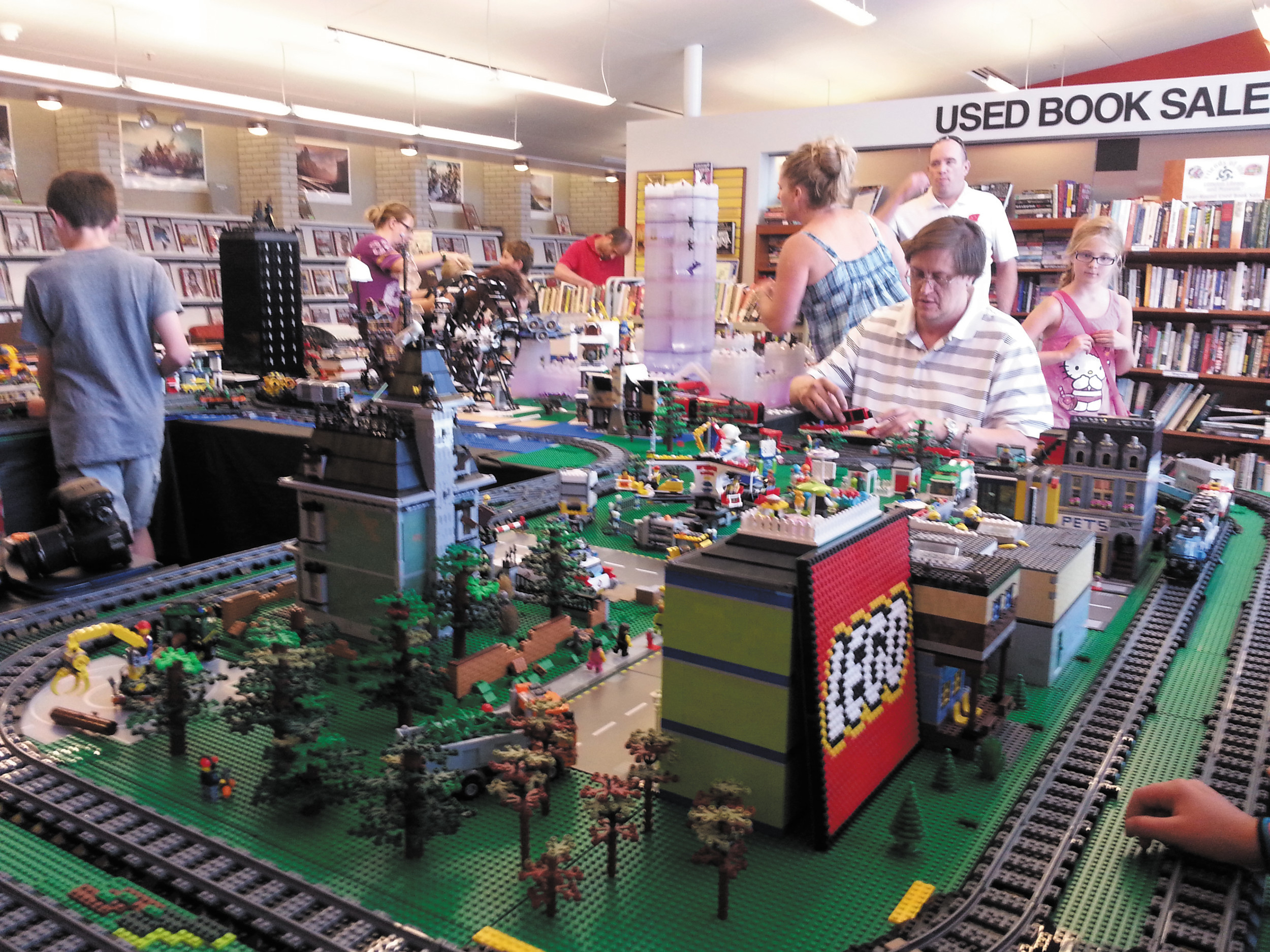 Ralph Copley of the Denver Lego Users Group works on the giant interactive Lego city the group displayed at Bemis Library Aug. 2.