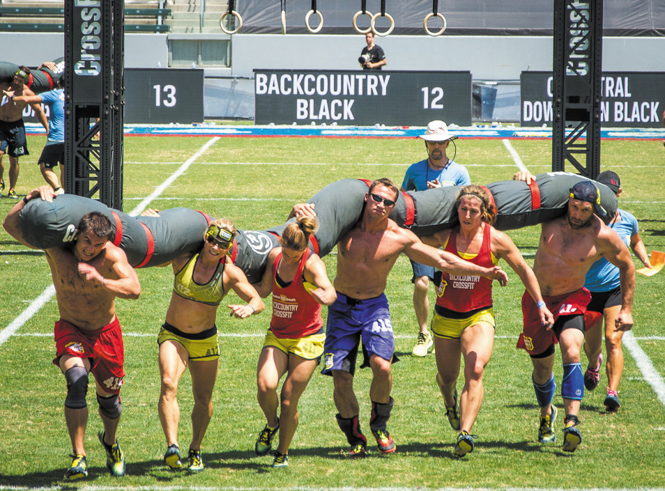 "The Backcountry Black team, from left, Dalton Spanbauer, Becky Conzelman, Stephanie Brady, Dave Foster, Meredeth Smith and Chris Dozois, compete in an event called the ""worm"" at the Reebok CrossFit Games in California. The team placed 15th out of 43 in the overall world competition."