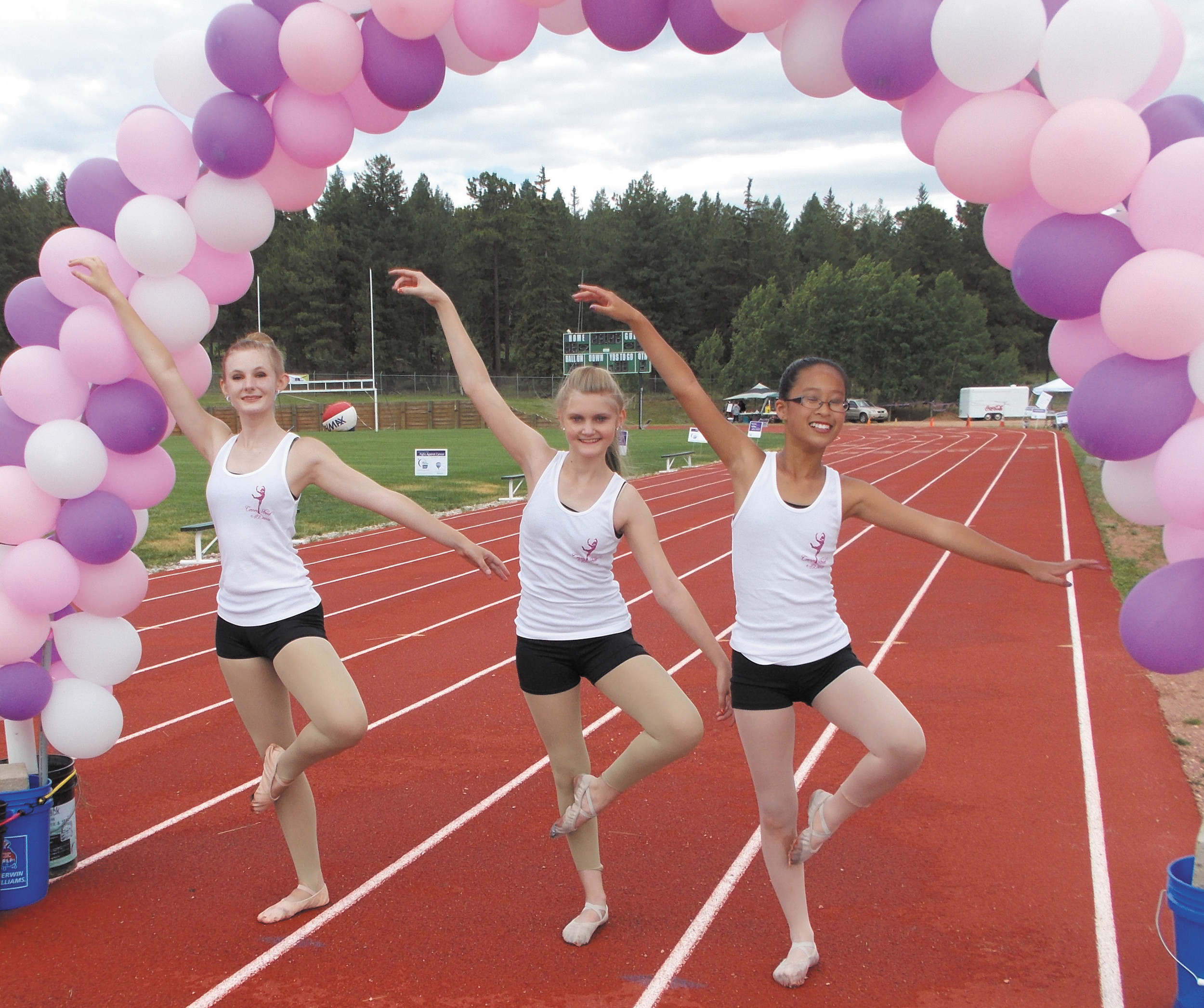 Cornerstreet Dance students Breanna Skelton, 17, left, Cheyenne Kramer, 11 and Devon Beckum, 11, have just finished performing for the small crowd gathered for the Relay for Life of Teller County on July 26.