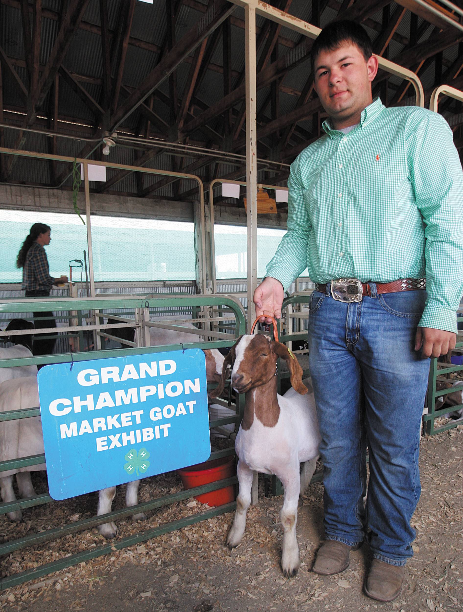 Clayton Liss, 18, of Elbert, poses with his grand-champion goat, Shenanigans.