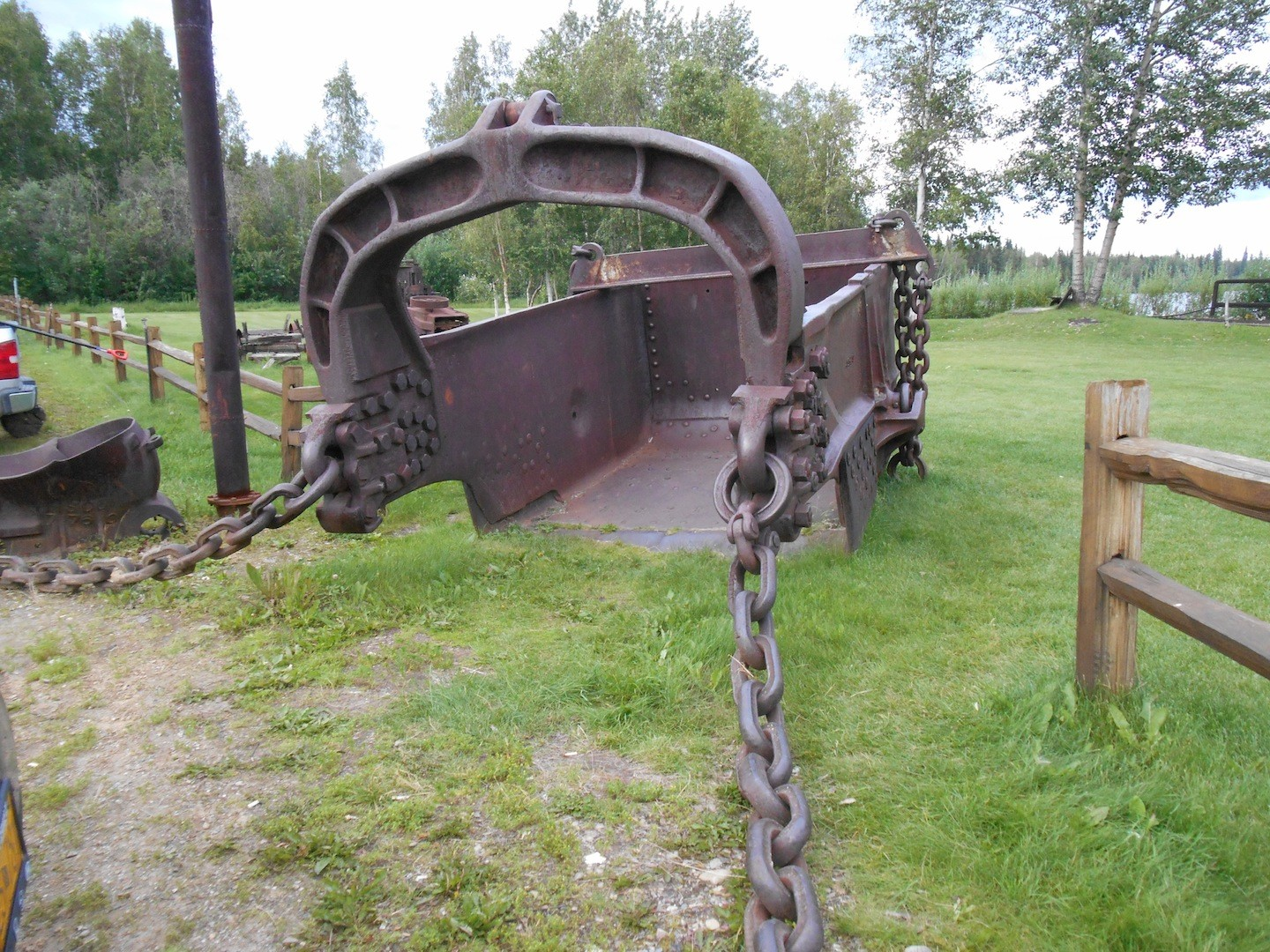 Dredge buckets like this one from Dredge #10 in Cripple Creek, Alaska, were used to efficiently work the placers.