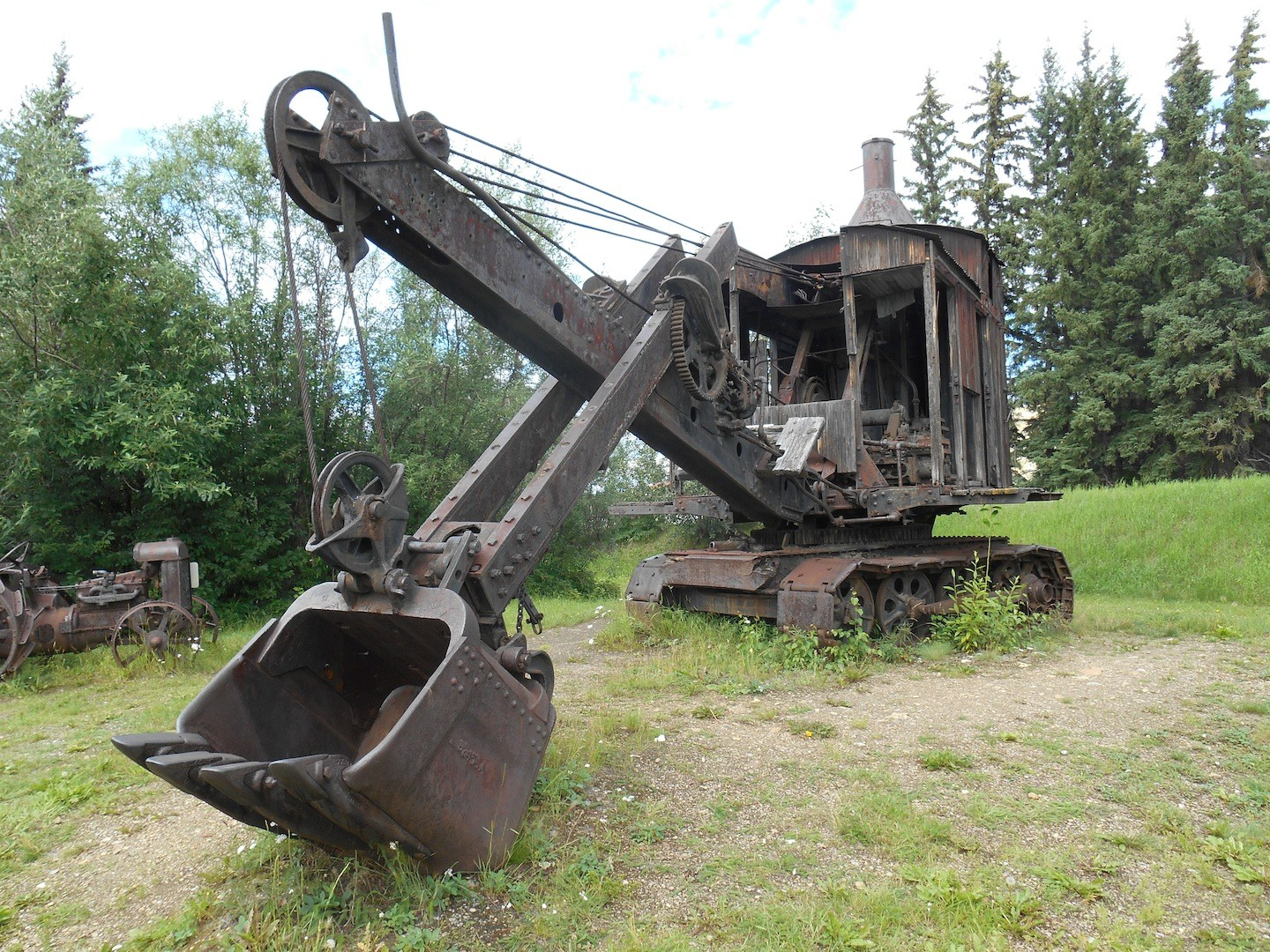 Steam shovels, like this Bucyrus shovel that first dug part of the Panama Canal were used to free gravel for dredging operations.