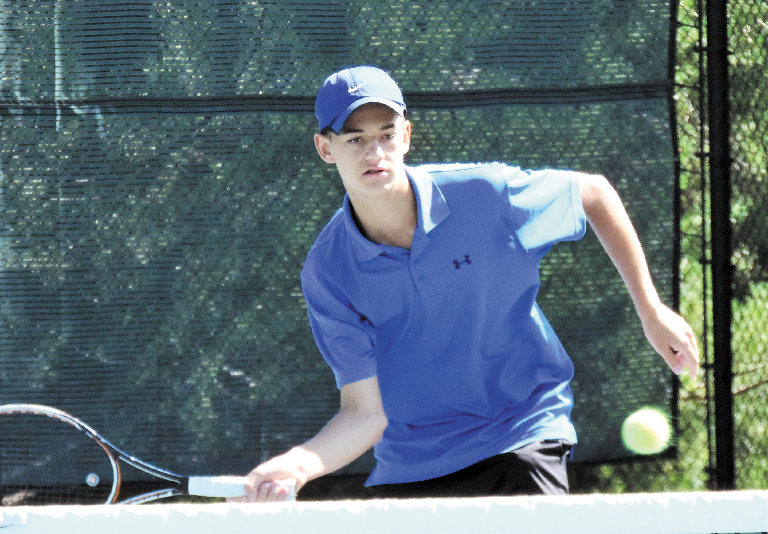 Cherry Creek's Robby Hill is competing to claim one of the three singles positions for the Bruins.