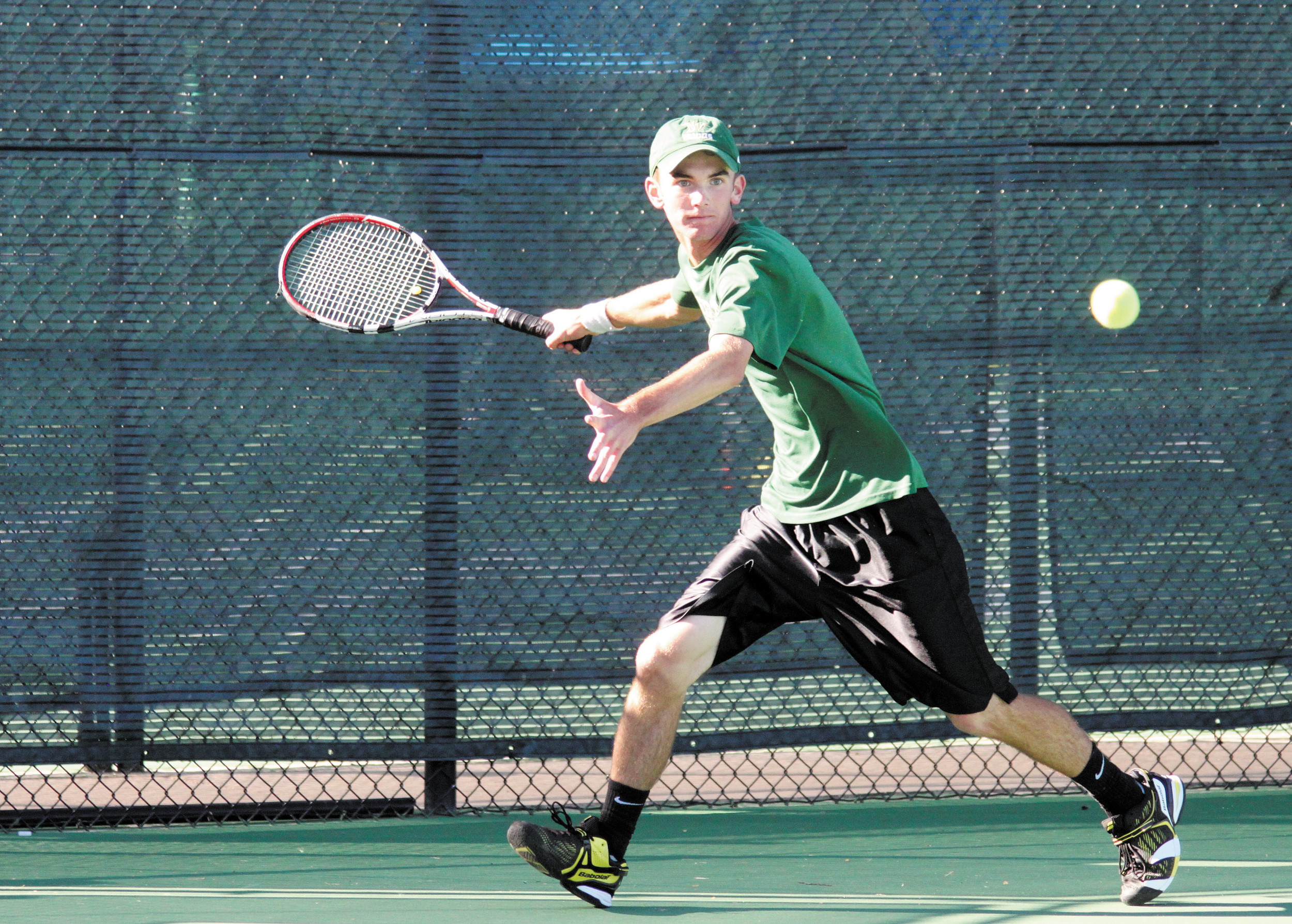 Mountain Vista's Ben Antonsen returns a volley during a 6-1, 6-1 victory over Columbine's Andy Wright to earn a Class 5A Regional title Oct. 3. 2013 at Redstone Park in Highlands Ranch. Antonsen finished second at state for the Golden Eagles and is the only singles player from last year's roster to return to the court this fall.
