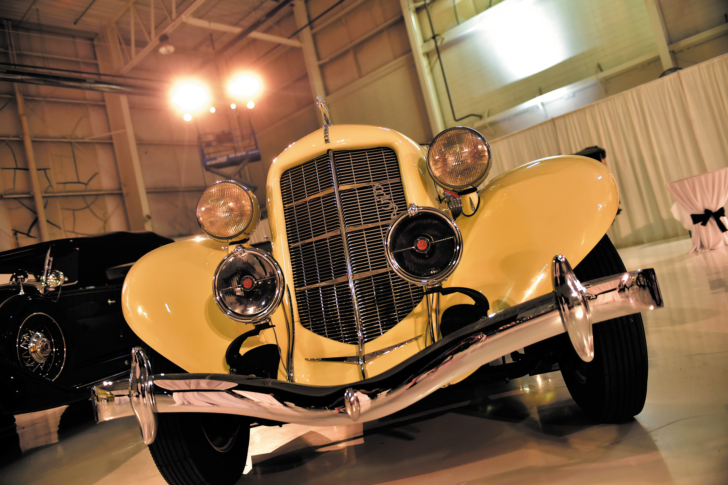 Just one of more than 100 automobile, this 1936 Auburn 851 Boattail Speedster, courtesy of the Clive Cussler Museum in Arvada add a dash of class to the hanger at the 2104 Morgan Adams Concours d'Elegance held Saturday, Aug. 23 at Centennial Airport. Now in its 12th year, the annual event helps raise awareness and funding for childhood cancer research.