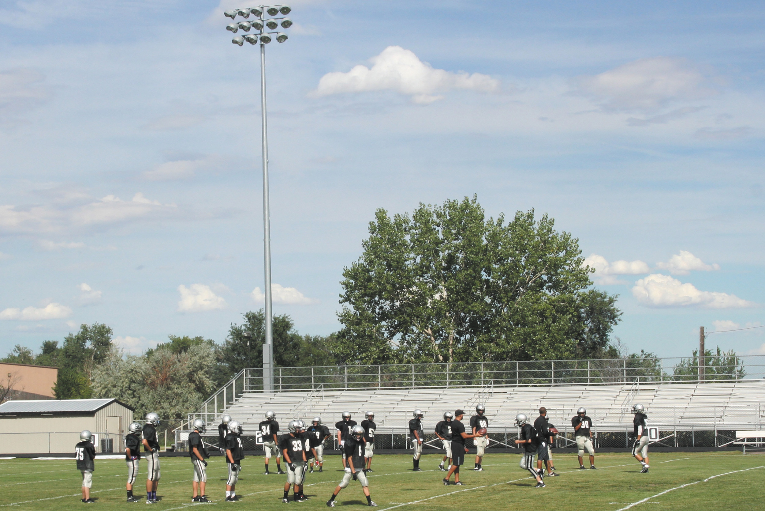 The Skyview Wolverines practice on the field at DiTirro Stadium Aug. 21. For the first time, Mapleton will be able to host evening games thanks to the newly installed lights.