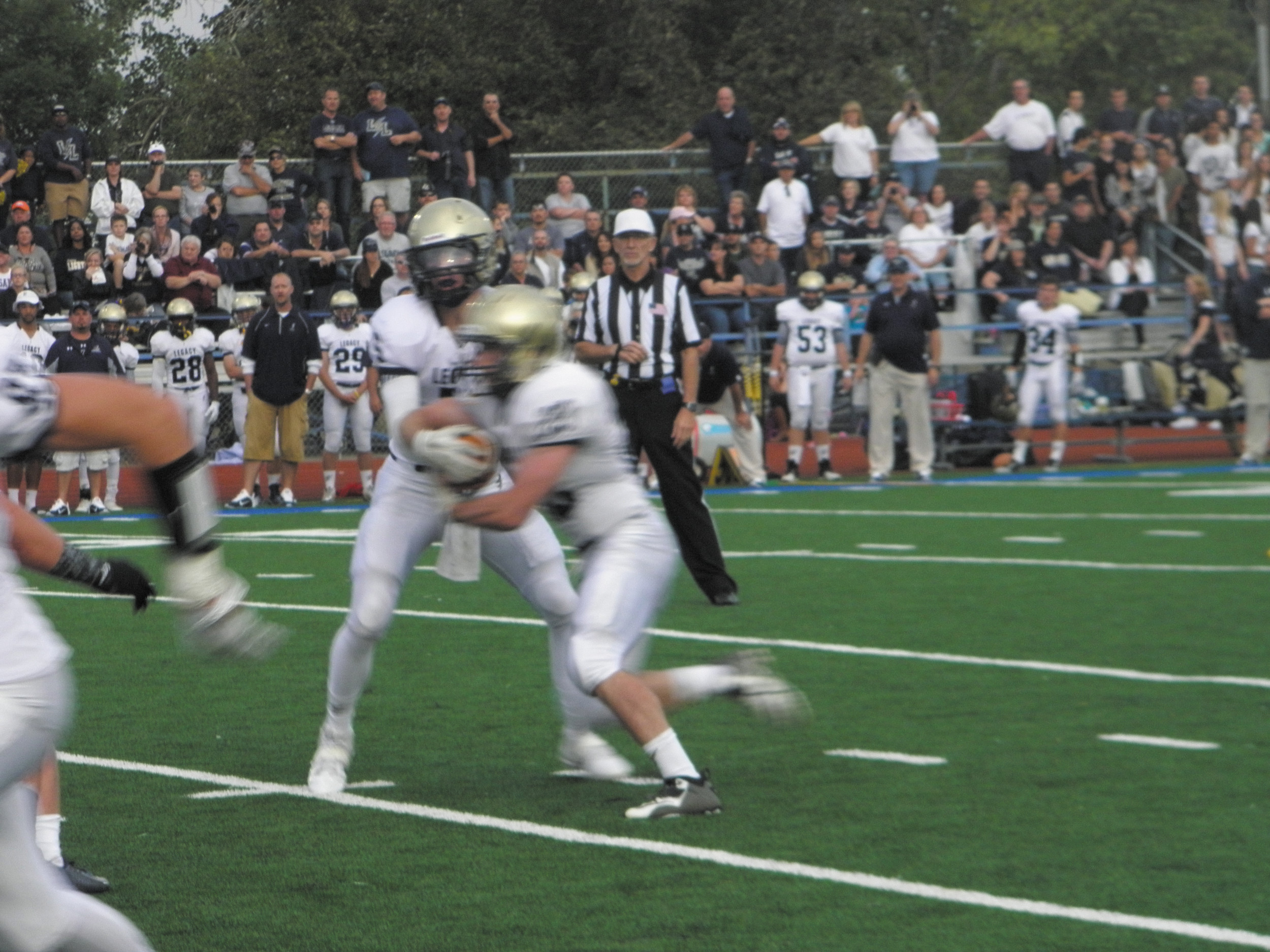 Legacy quarterback Matt Lynch hands off to Conner Connolly.