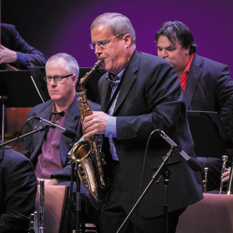 Steve Weist, new artistic director, left; Art Bouton, executive director and saxophone player, center; and Al Hood (background) rehearse for a Colorado Jazz Repertory Orchestra concert.