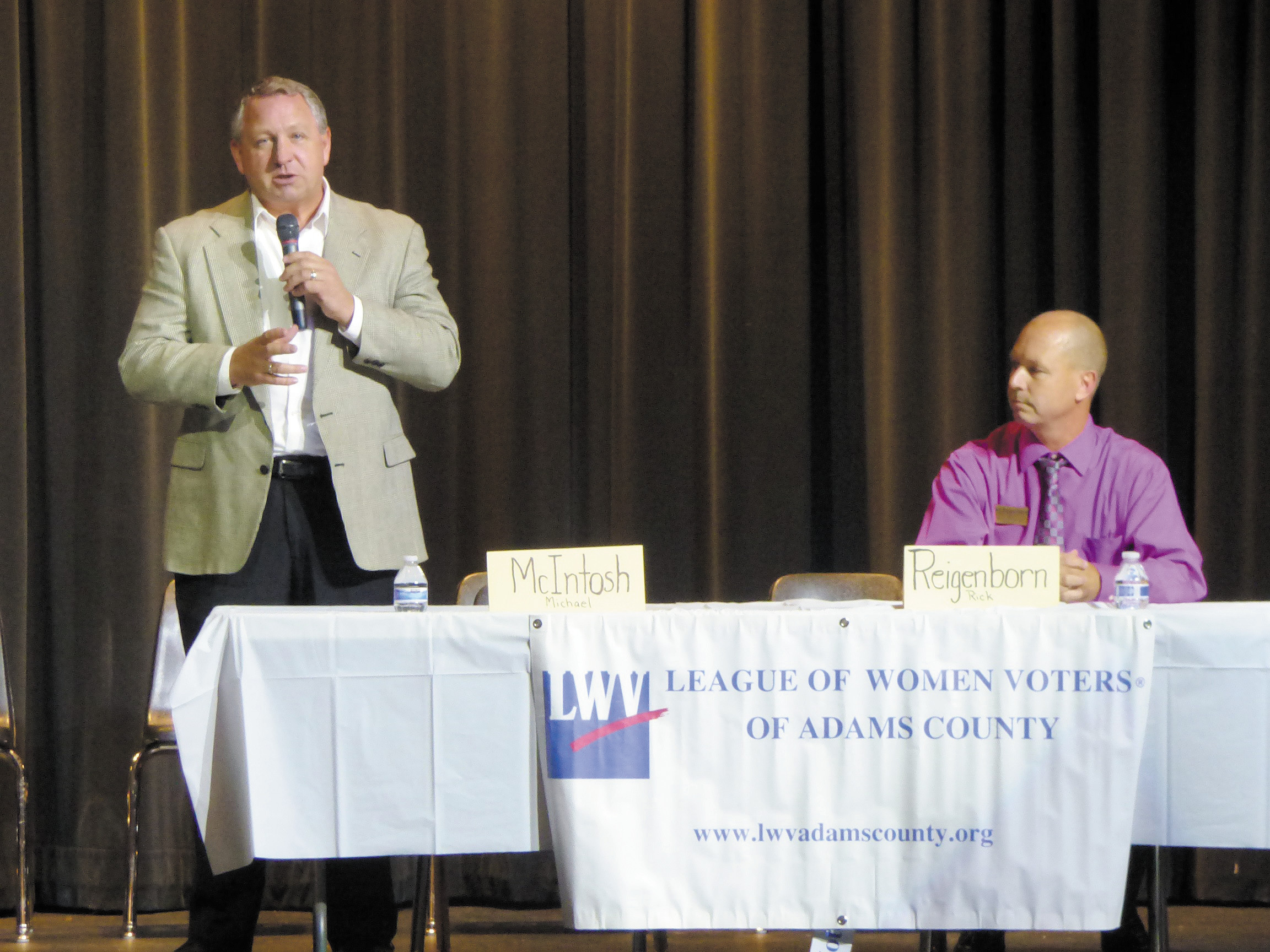 Republican candidate Mike McIntosh and Democratic candidate Rick Reigenborn faced off Sept. 30 during a County Candidate Meeting hosted by the League of Women Voters of Adams County at Skyview Campus in Thornton. ?Photo by Tammy Kranz