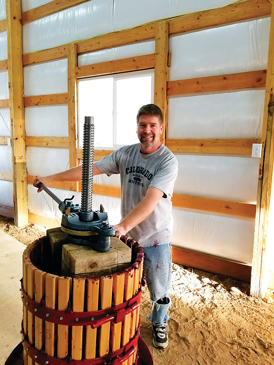 Tony Baker, owner of Third Bridge winery, presses grapes as part of the wine-making process. Third Bridge wines will be among the featured beverages at the Oct. 6 Wine in the Pines event held on Main Street in Elizabeth. The event featuring wine tasting and entertainment will run from 4 to 8 p.m.