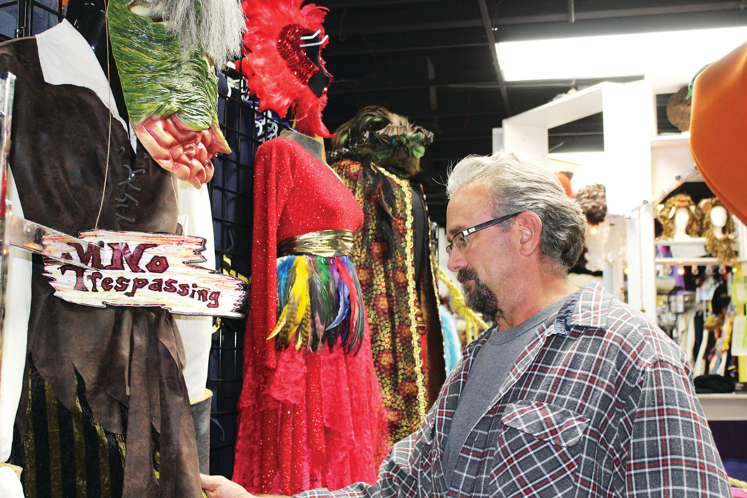 Dale Smith prepares for Halloween by shopping for costumes inside Disguises, a costume shop in Lakewood.