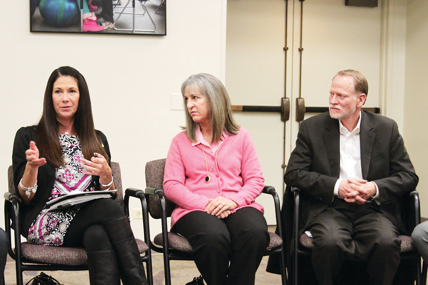 Arapahoe High School principal Natalie Pramenko, left, speaks at a Littleton Public Schools roundtable on Dec. 10. Next to her are Desiree and Michael Davis, whose daughter Claire was killed by a classmate in 2013.