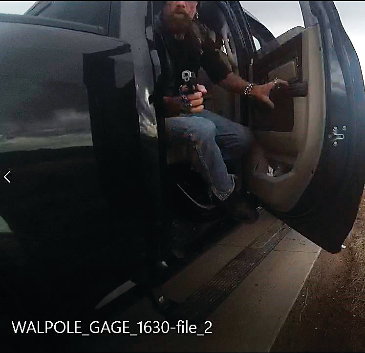 Footage from a deputy's body camera shows Paul Askins pointing a stolen semi-automatic pistol at a Douglas County Sheriff's Office Deputy, moments before being shot to death by authorities.