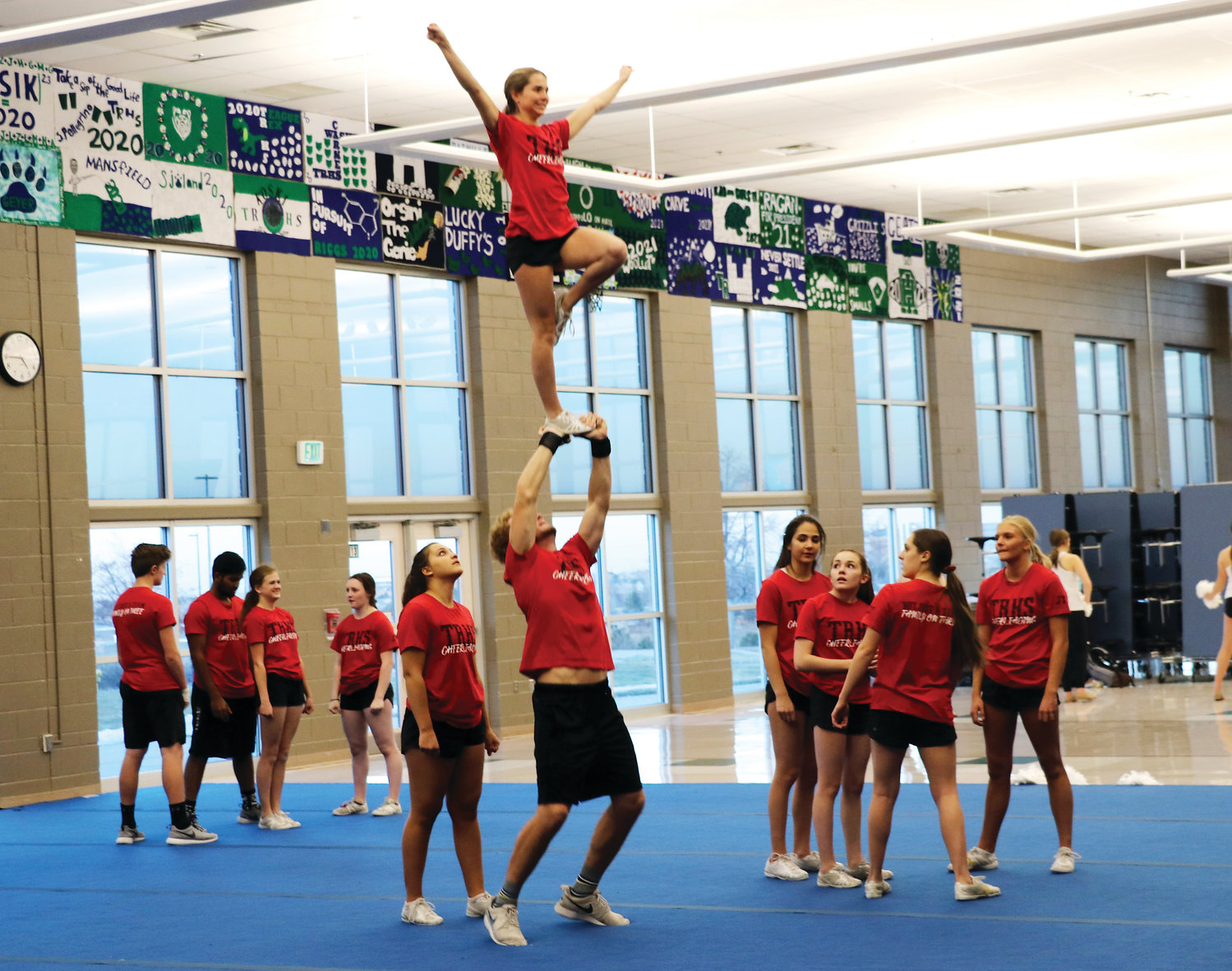 ThunderRidge High School's co-ed varsity cheer team prepares for the national championship coming up in early February. They hope to continue their winning streak. This season, for the first time in the school's history, the co-ed team won the state championship.