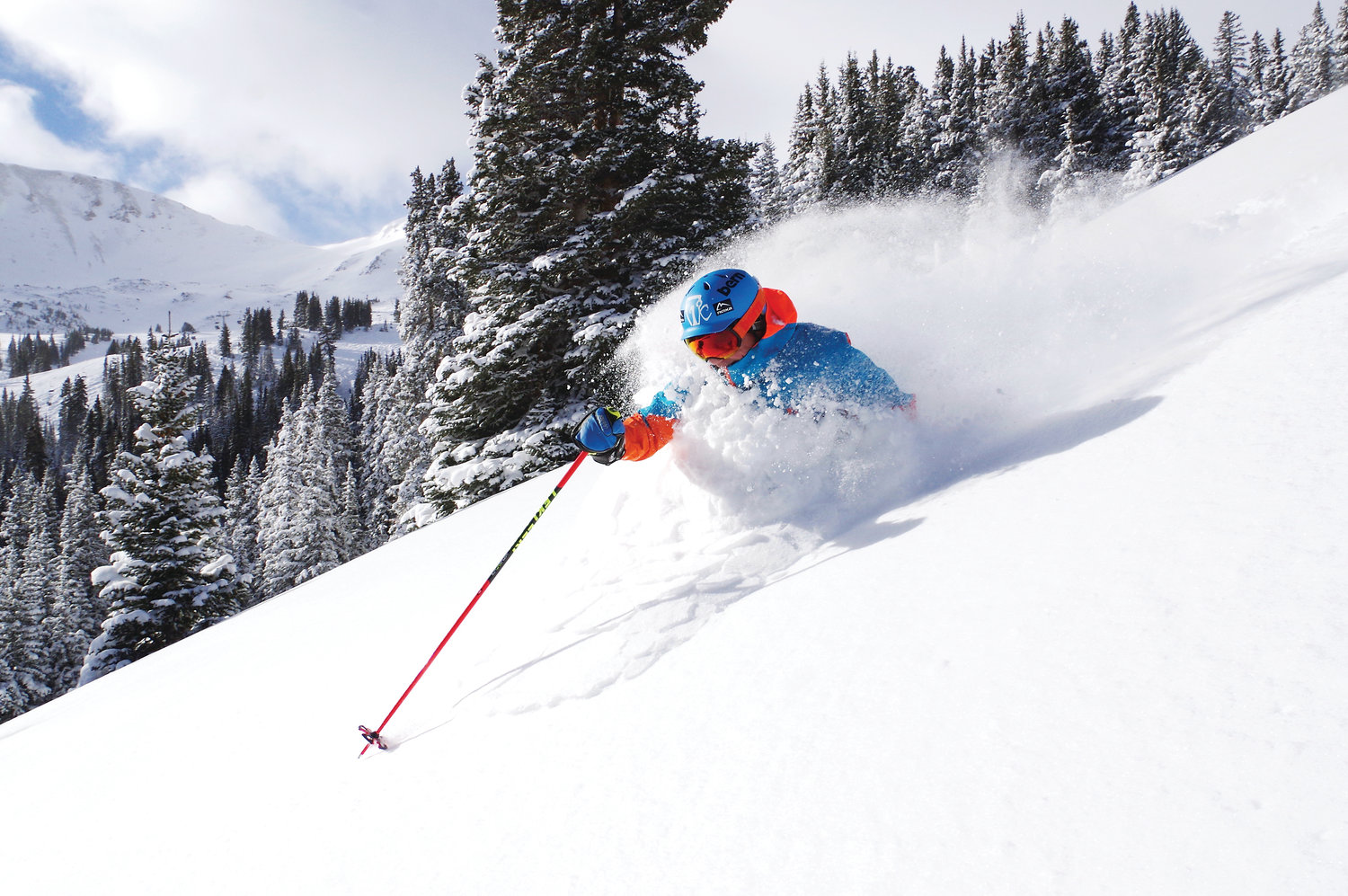 A skier skis through the powder at Loveland Ski Resort.